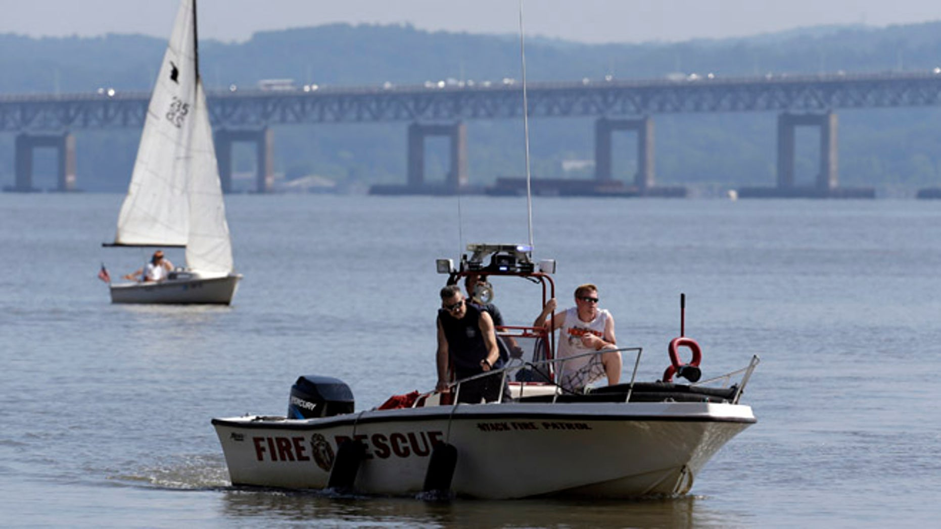July 27, 2013: Rescue workers on a boat search the Hudson River south of the Tappan Zee Bridge for two people who went missing following a boat crash in Piermont, N.Y. Two people are missing and four others are injured after their boat struck a barge under the bridge, according to the Coast Guard.