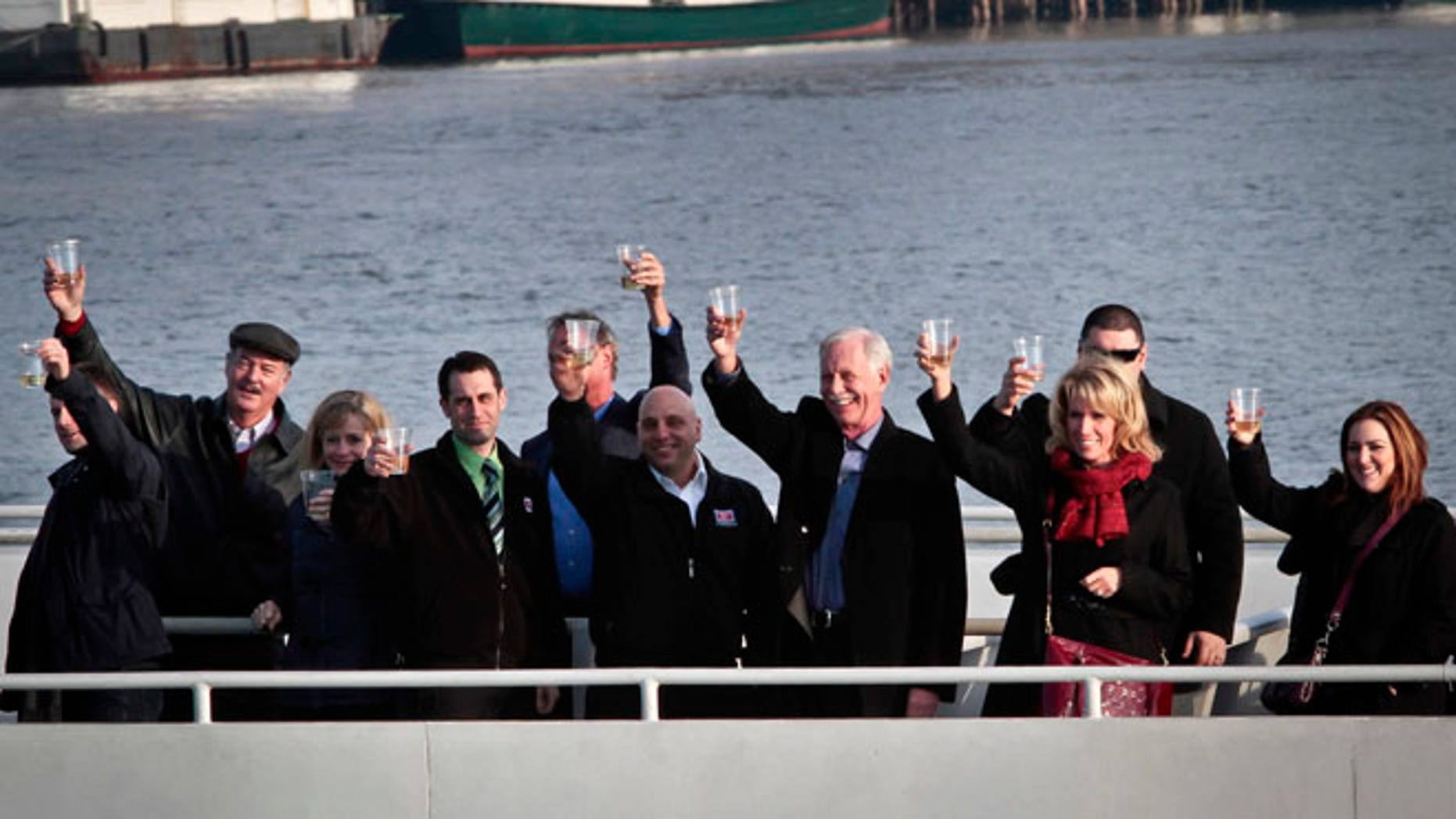"""Jan. 15, 2014: Captain Chesley """"Sully"""" Sullenberger III, fourth from right, pilot who safely glided U.S. Airways Flight 1549 with155 passengers and crew to a water landing 5 years ago, join survivors and rescuers in a toast marking the anniversary of the event known as the """"miracle on the Hudson,"""" in New York."""