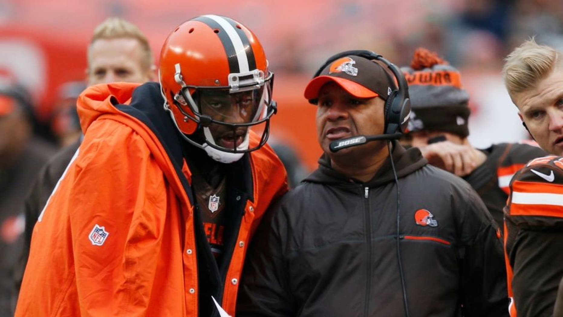 Cleveland Browns head coach Hue Jackson, right, talks with quarterback Robert Griffin III in the first half of an NFL football game against the San Diego Chargers, Saturday, Dec. 24, 2016, in Cleveland. (AP Photo/Ron Schwane)