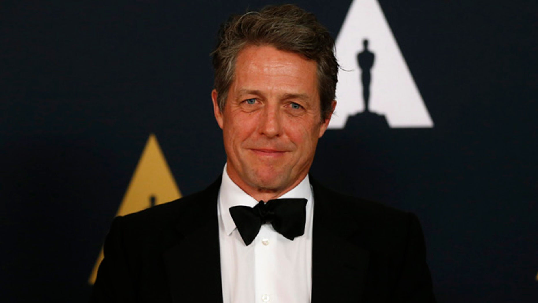 Hugh Grant says becoming a father at age 50 changed his disposition.