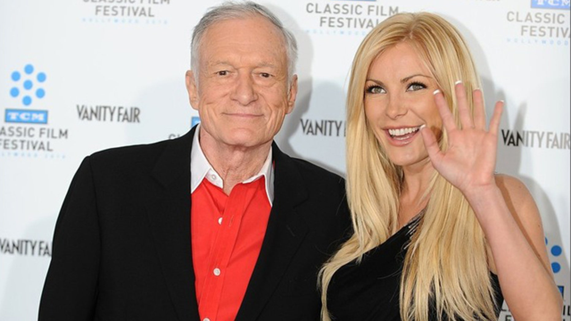 April 22, 2010:Hugh Hefner arrives with Playmate and actress Crystal Harris