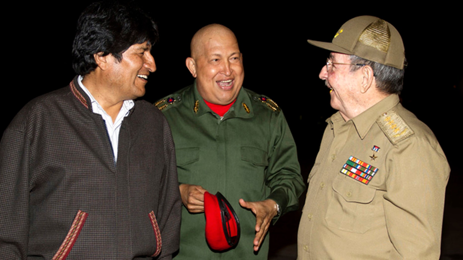 Sept. 18: Latin America  leaders, from left, Bolivia's President Evo Morales, Venezuela's President Hugo Chavez and Cuba's President Raul Castro speak at the Jose Marti airport in Havana, Cuba