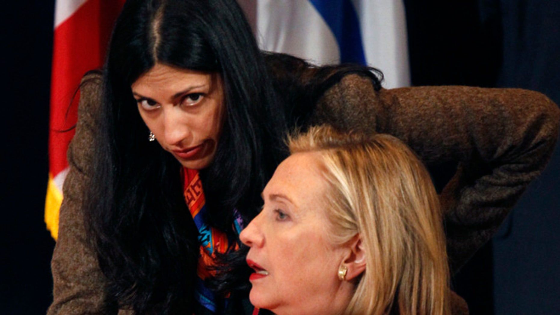 Sept. 20, 2011: U.S. Secretary of State Hillary Clinton talks with her deputy chief of staff, Huma Abedin, during the Open Government Partnership event in New York. (Reuters)