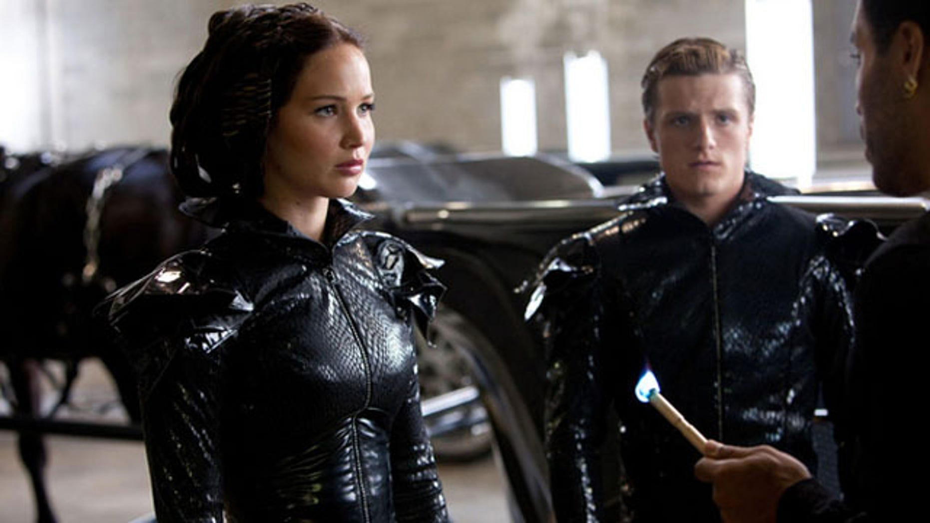 """Hunger Games"" heroine Katniss Everdeen and fellow tribute Peeta Mellark wait to be lit on fire before making their fiery public debut."