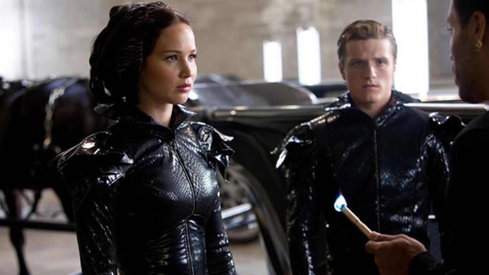 """Hunger Games"" heroine Katniss Everdeen and fellow tribute Peeta Mellark wait to be lit on fire before making their fiery public debut."