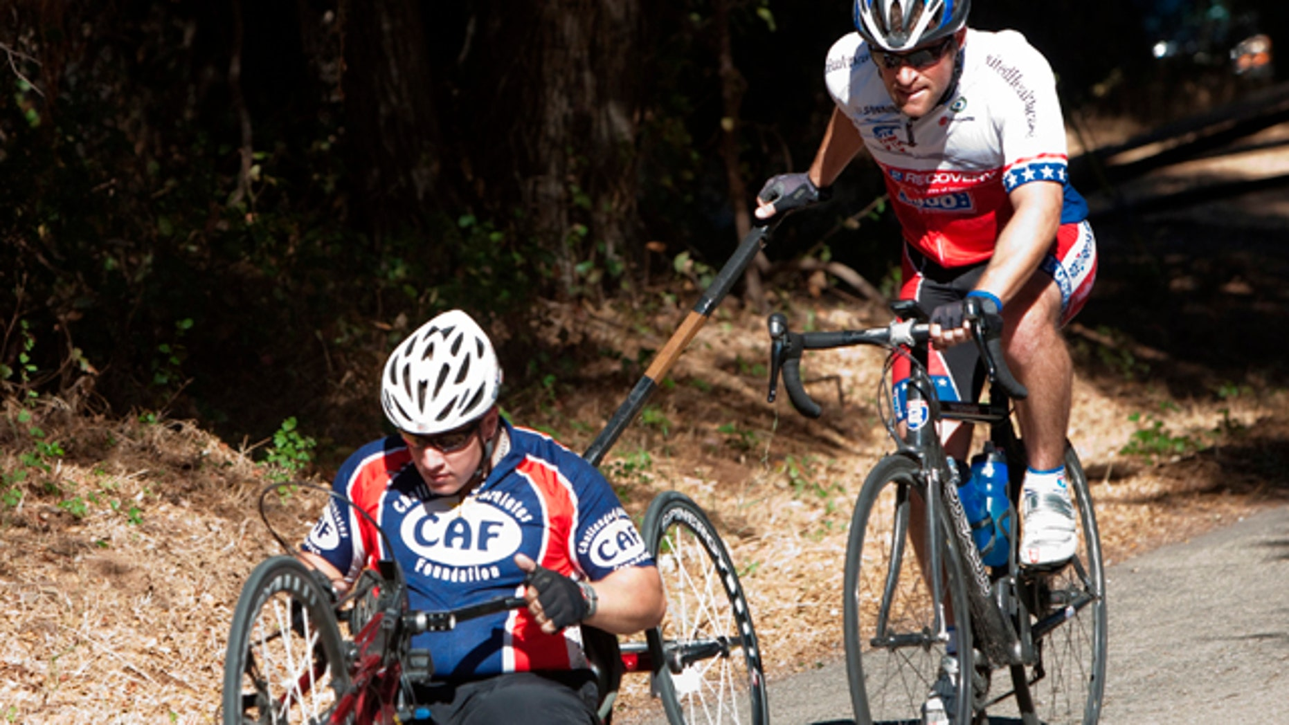 This handout photo, taken in October 2010, provided by Ride 2 Recovery, shows Clay Hunt, right, with Nate Hunt in the 2010 California Ride. Hunt epitomized a vibrant Iraq veteran that he represented one in a public service announcement that reminded veterans they weren't alone. On March 31, Hunt bolted himself in his Houston apartment and shot himself. (AP/Ride 2 Recovery)