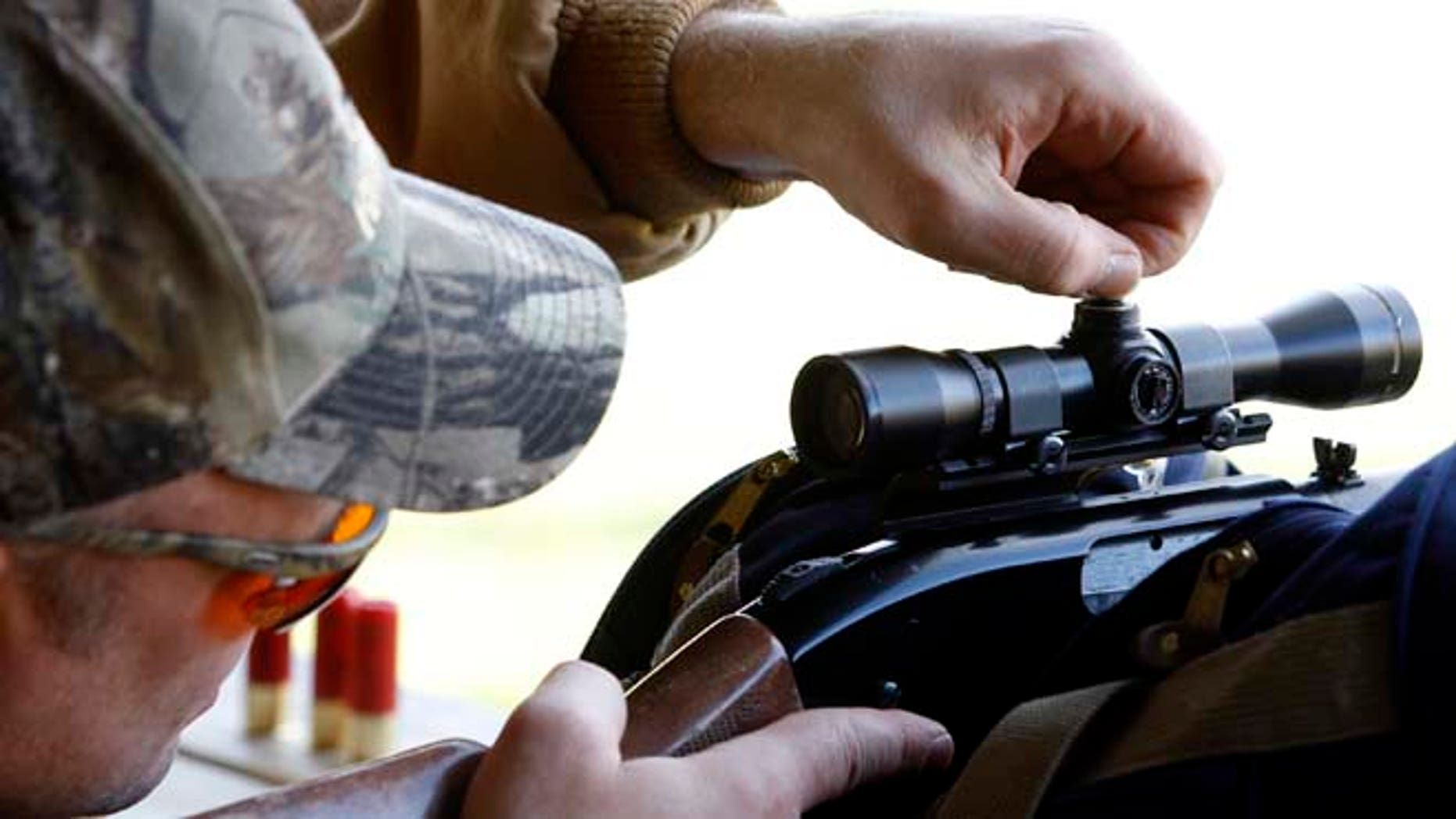 In this file photo, a hunter dials in his scope at a firing range in Joliet, Ill,