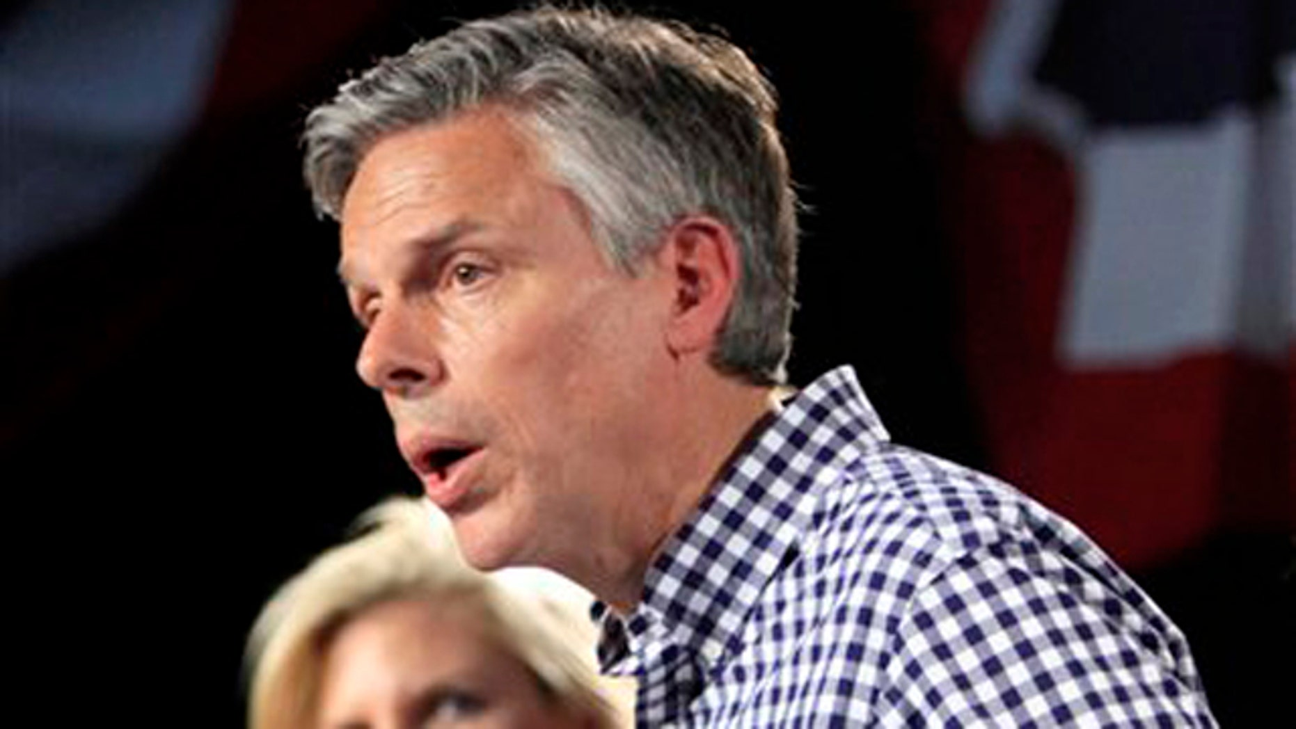 In this June 21, 2011, file photo, Mary Kaye Huntsman listens as her husband, Republican presidential candidate and former Utah Gov. Jon Huntsman, Jr., speaks at the Town Hall in Exeter, N.H.