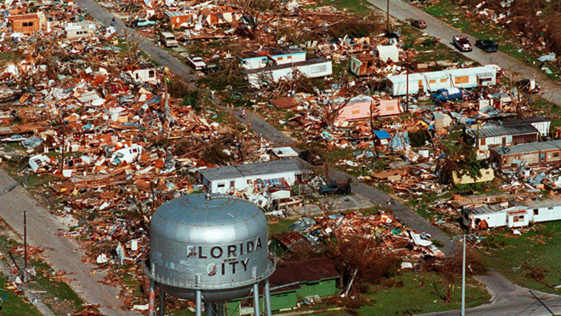 This Aug. 25, 1992 file photo shows the water tower, a landmark in Florida City, Fla. still standing over the ruins of the Florida coastal community that was hit by the force of Hurricane Andrew. Cities like Tampa, Houston, Jacksonville and Daytona Beach historically get hit with major hurricanes every 20 to 40 years, according to meteorologists. But those same places have now gone at least 70 years, sometimes more than a century, without getting smacked by those monster storms, according to data analyses by an MIT hurricane professor and The Associated Press.