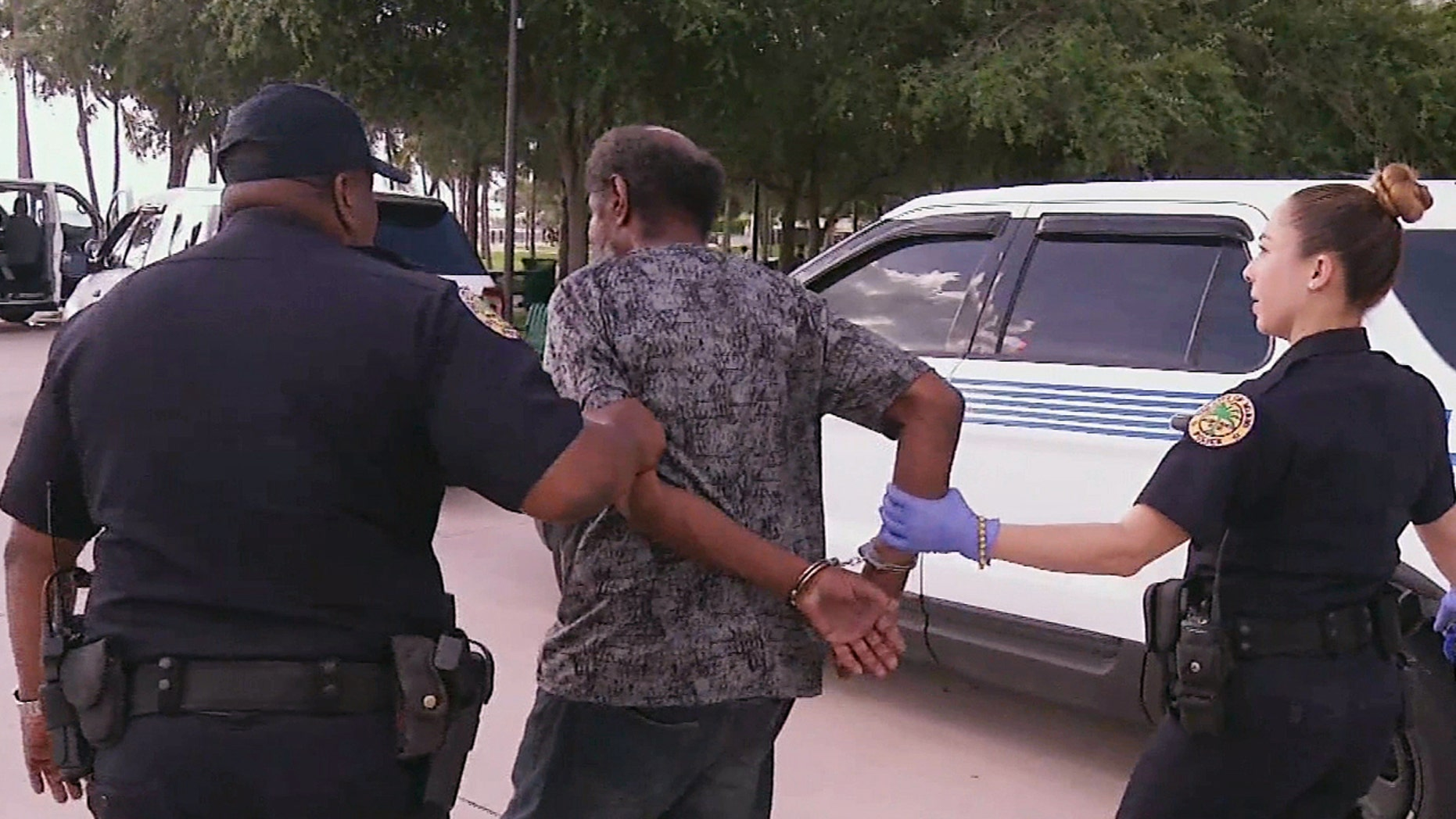 In this video clip from Sept. 8, 2017, officials in Miami detain a person who is homeless ahead of powerful Hurricane Irma.