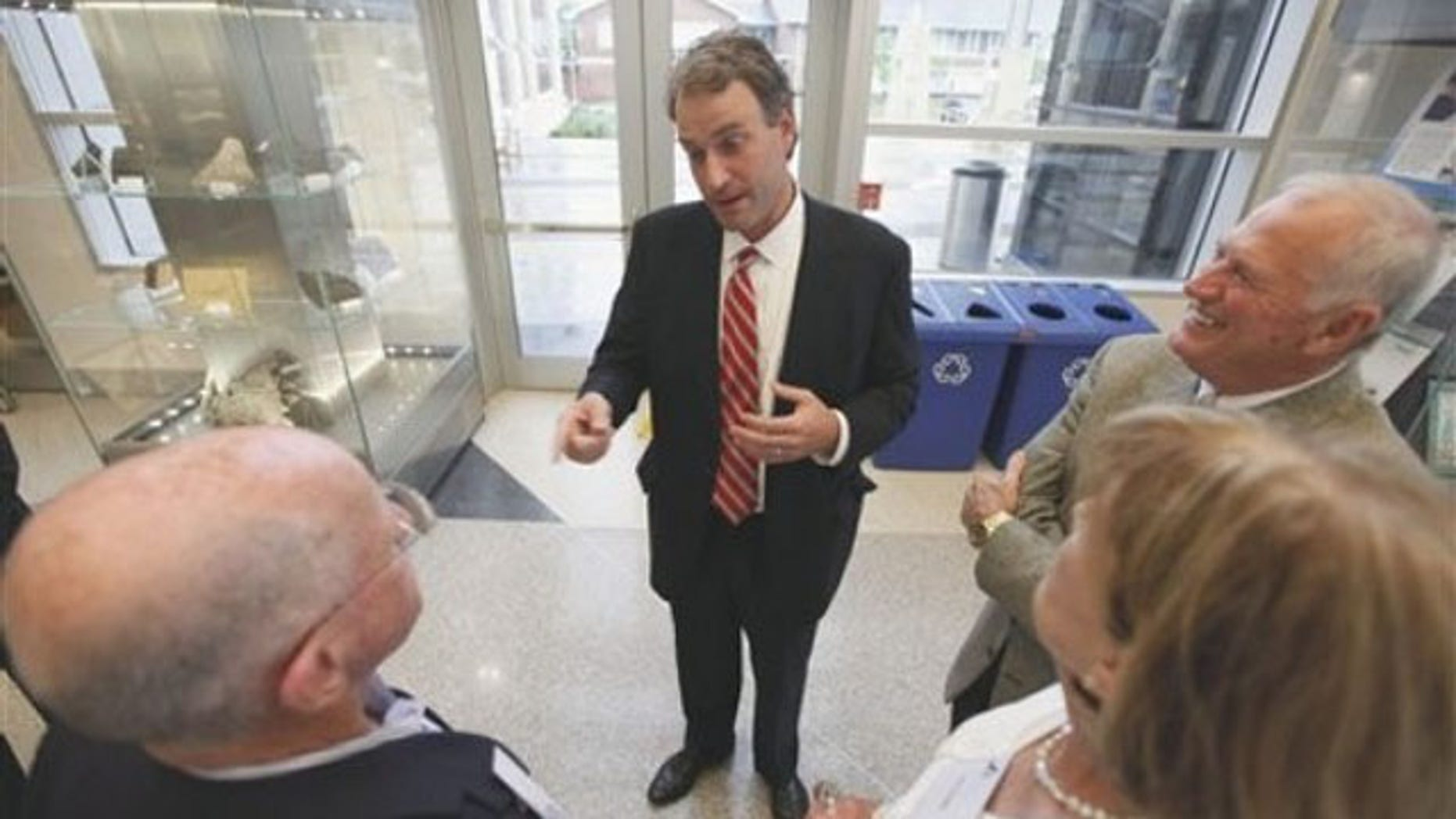 Virginia state Sen. Robert Hurt, center, talks to constituents prior to the start of a dinner at the Virginia Museum of Natural History in Martinsville, Va., July 13. (AP Photo)