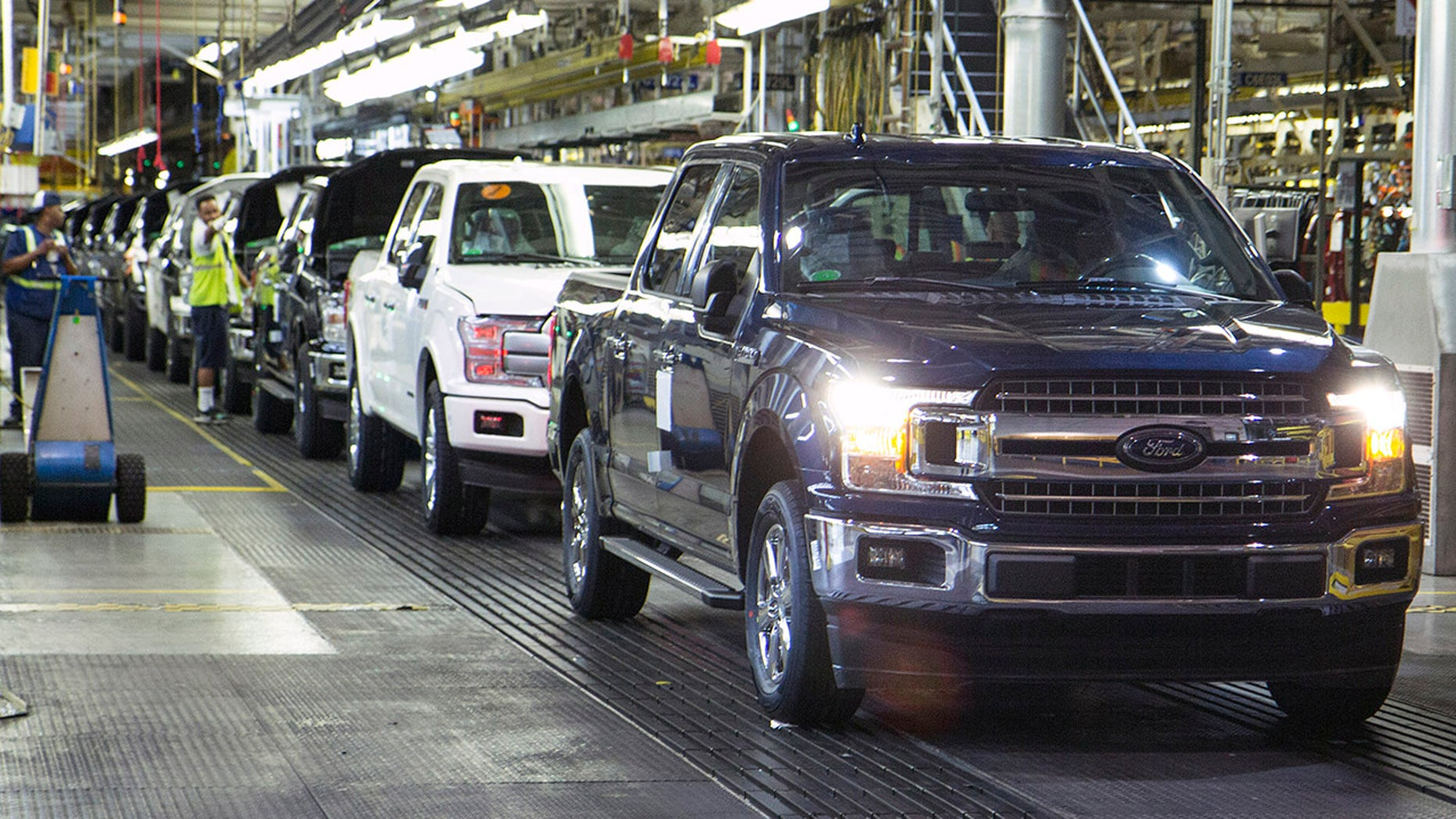 The first ford f 150 truck rolls off the line this morning at dearborn truck