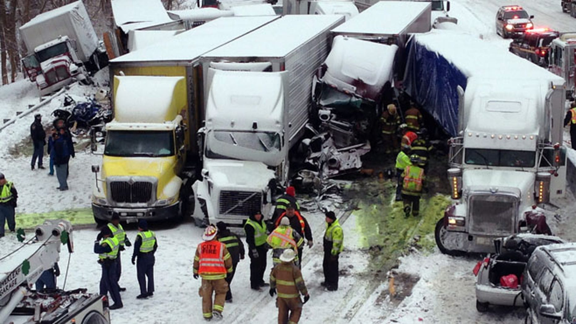 Jan. 23, 2014: In this photo provided by the Indiana State Police, emergency crews work at the scene of a massive pileup involving about 15 semitrailers and about 15 passenger vehicles and pickup trucks along Interstate 94.