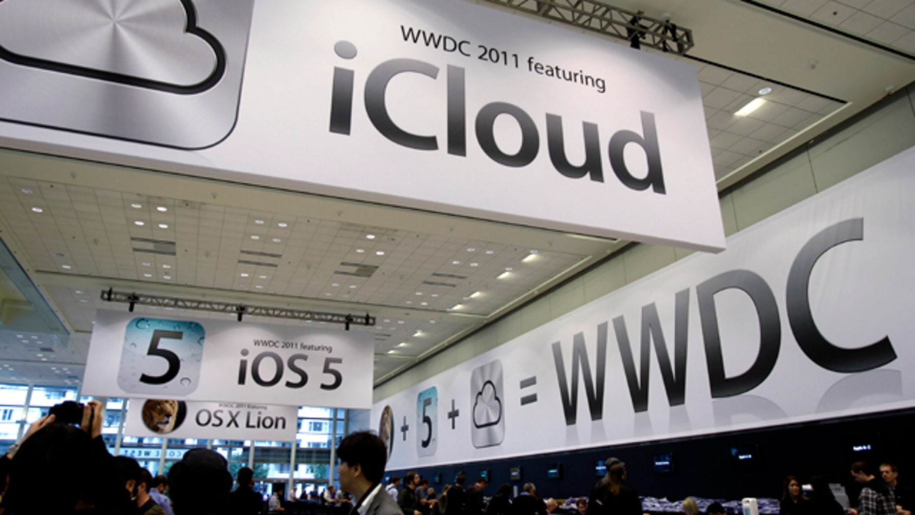 June 6, 2011: Posters on display at the Apple Worldwide Developers Conference in San Francisco tout the new iCloud service. Apple CEO Steve Jobs is scheduled to take a break from medical leave Monday to announce iCloud.