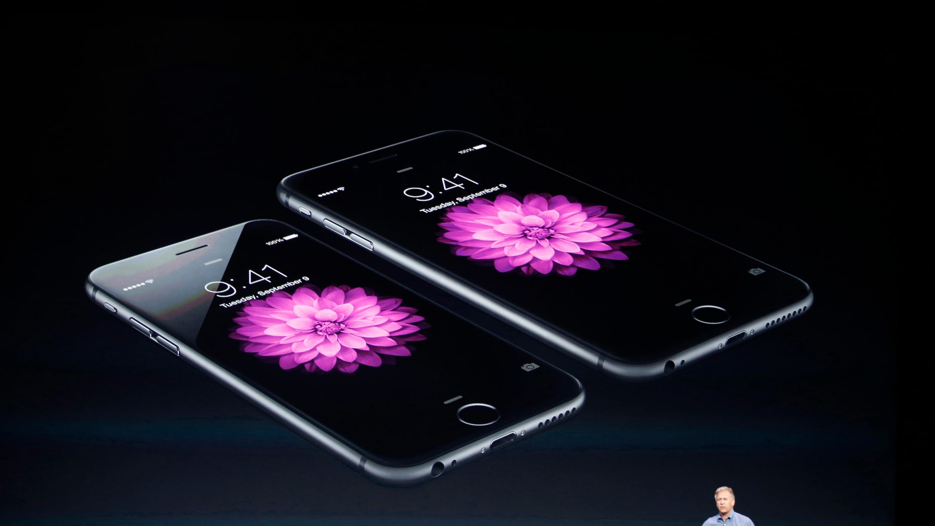 Phil Schiller, Senior Vice President at Apple, speaks about the iPhone 6 (foreground) and the iPhone 6 Plus during an Apple event at the Flint Center in Cupertino, Calif., Sept. 9, 2014.