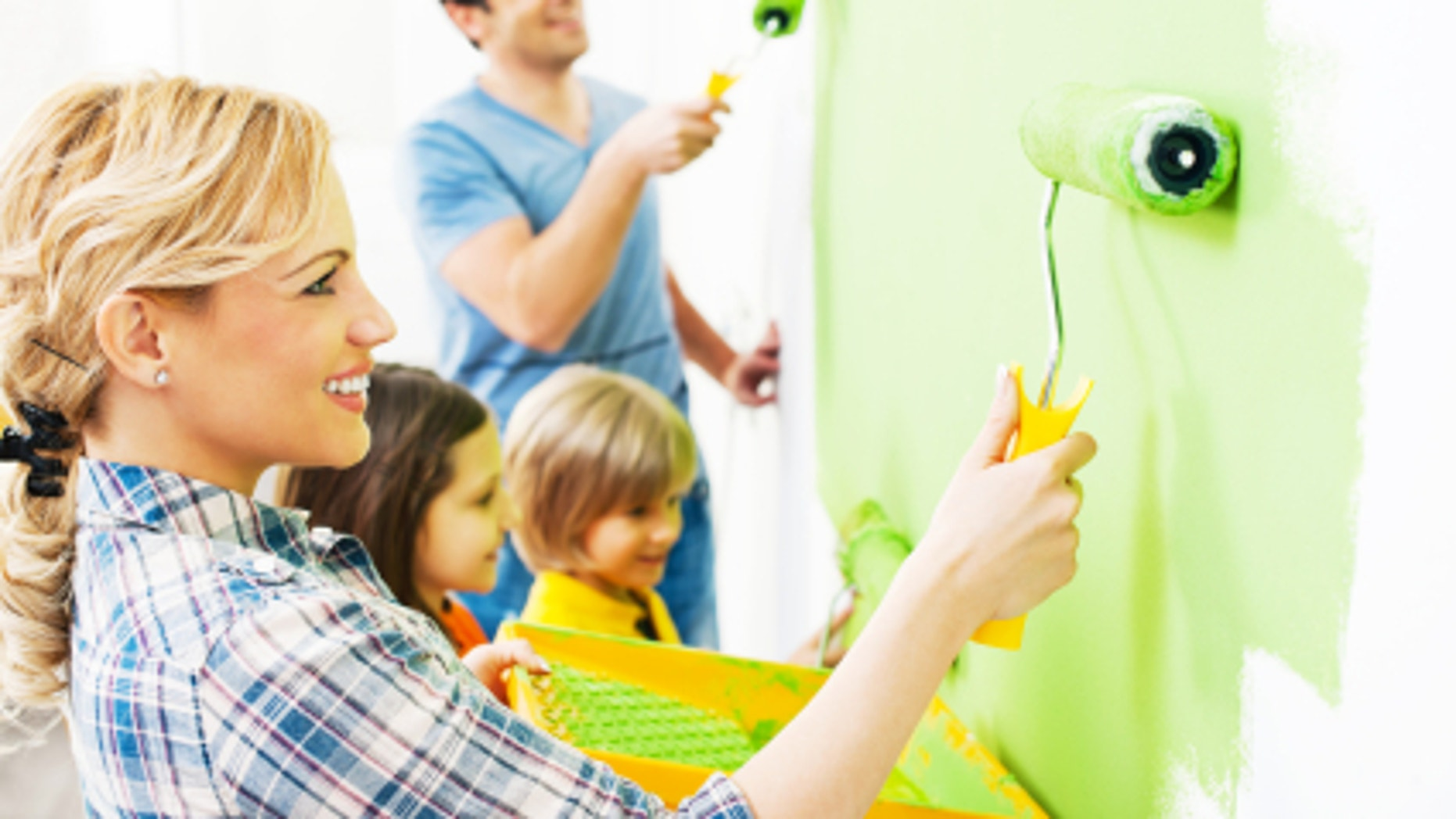 Portrait of a happy family holding paint rollers and painting wall in green.[url=http://www.istockphoto.com/search/lightbox/9786778][img]http://dl.dropbox.com/u/40117171/family.jpg[/img][/url]
