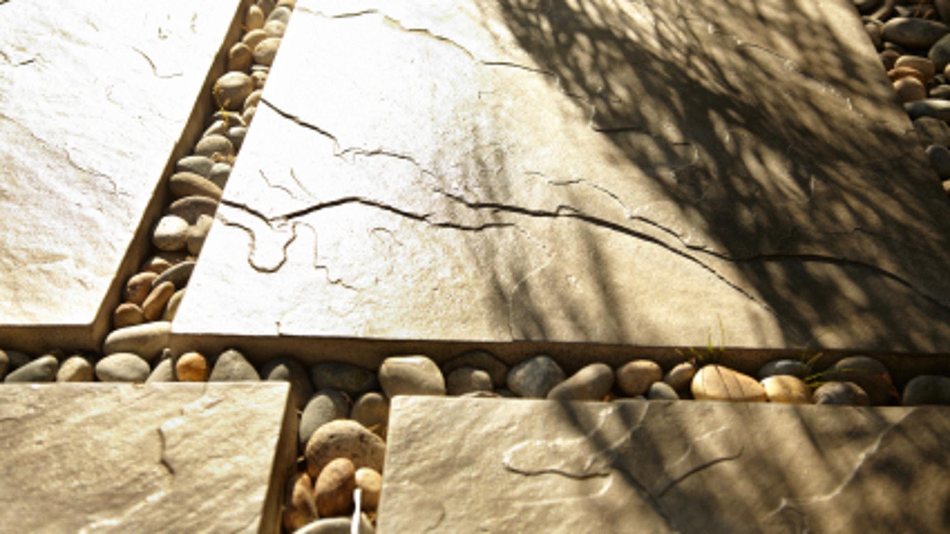 A gray slate tile patio.