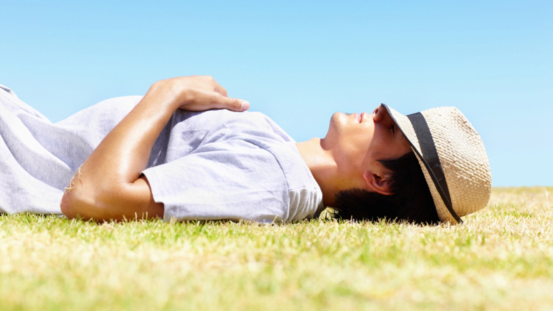 Young guy taking a rest in the hot sun - Outdoor