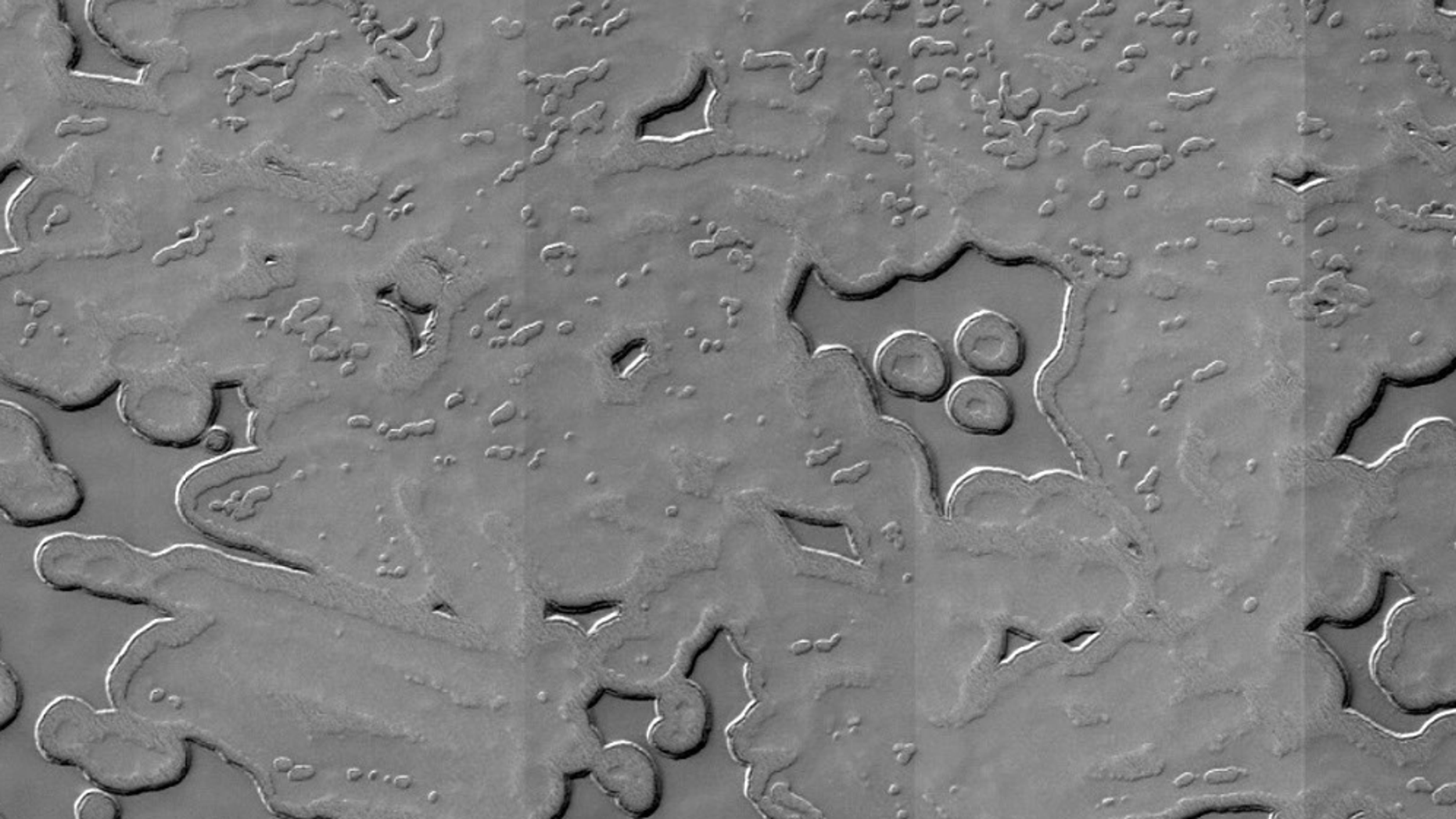 An image taken by NASA's Mars Reconnaissance Orbiter shows a muppet-shaped figure on the planet's southern pole.