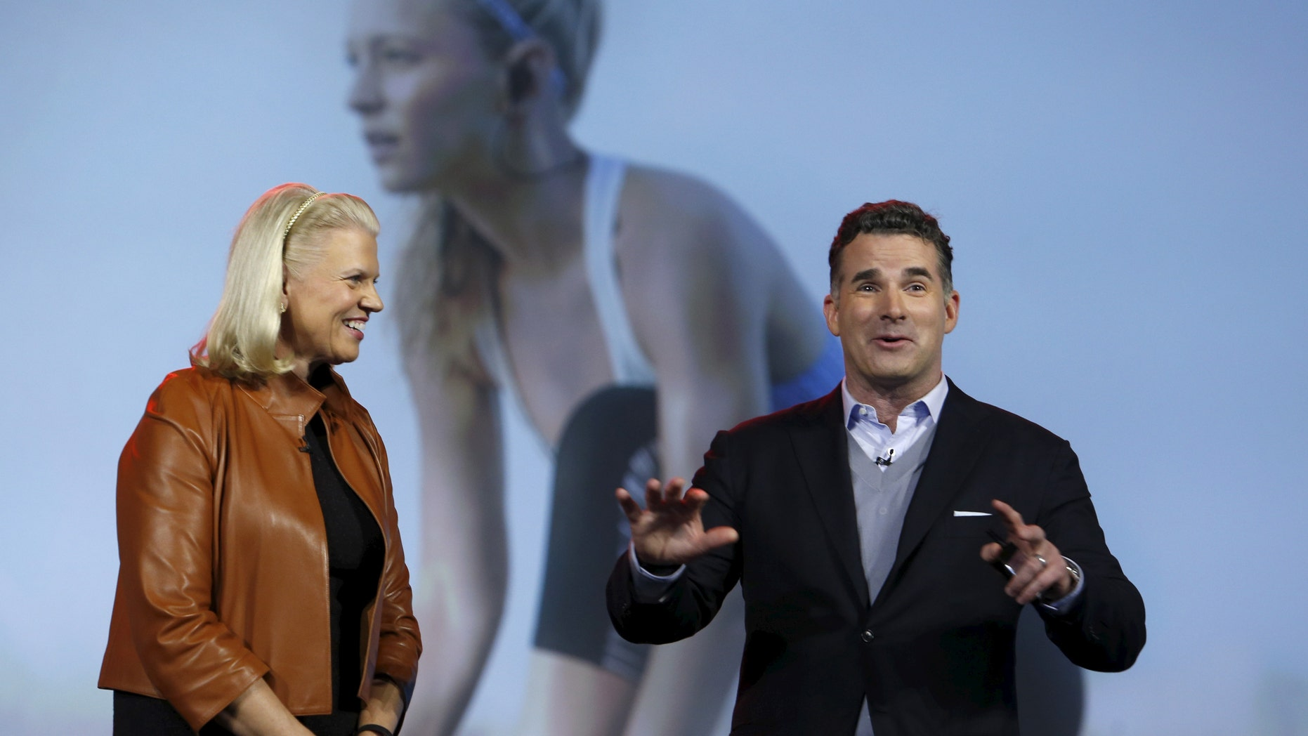 Ginni Rometty (L), chairman, president and CEO of IBM, listens to Kevin Plank, founder and CEO of Under Armour, during her keynote address at the 2016 CES trade show in Las Vegas, Nevada, Jan. 6, 2016. (REUTERS/Steve Marcus)