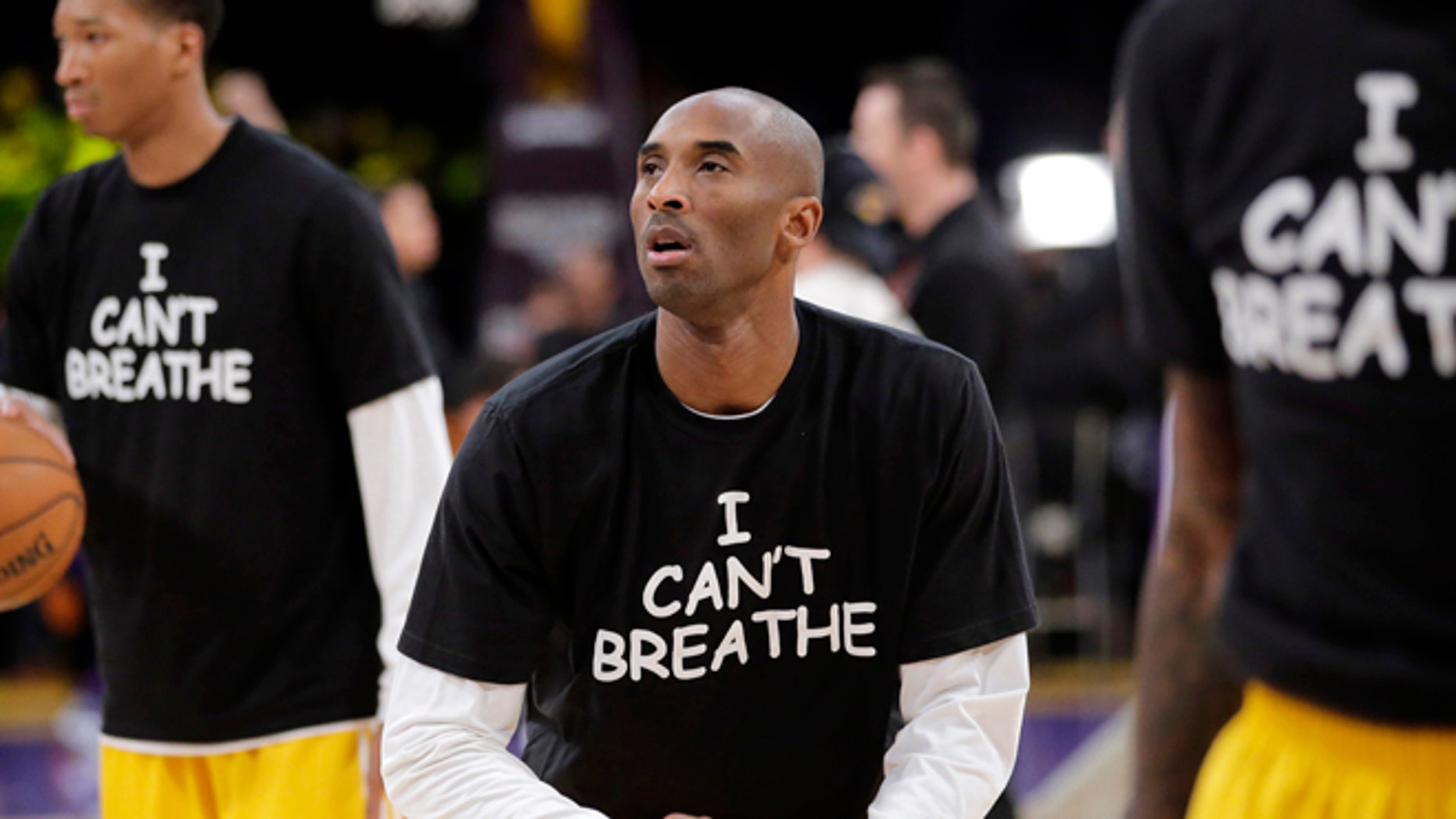 Dec. 9, 2014: Los Angeles Lakers' Kobe Bryant, center, warms up before an NBA basketball game against the Sacramento Kings in Los Angeles. An Illinois woman wants to trademark the phrase on T-shirts and hoodies.
