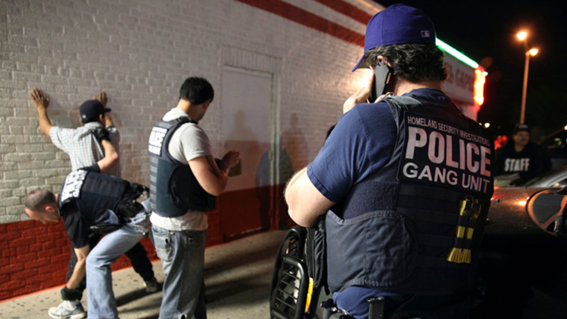 Immigration agents detain a man in Dallas, Texas.