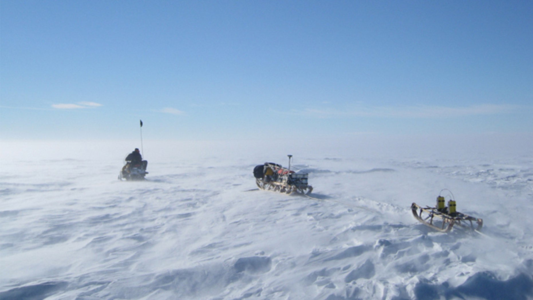 What wonders lie beneath? Radar equipment is driven across Antarctic ice during field work that revealed a massive rift.