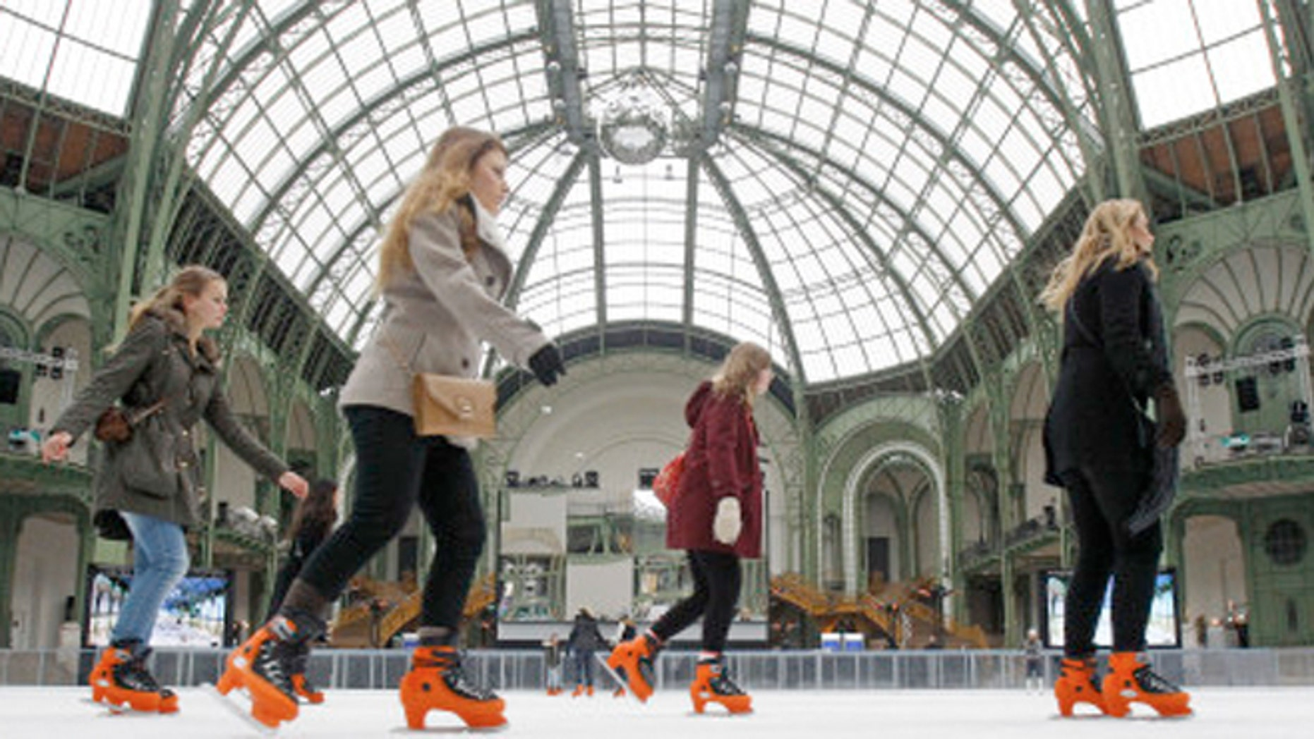 Dec. 13, 2012: Skaters take advantage of the giant ice rink set up under the famous glass roof of the Grand Palais, in Paris.