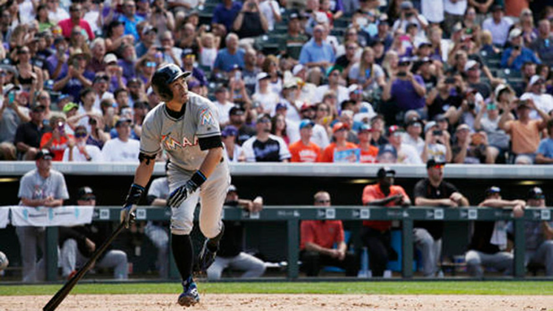Miami Marlins' Ichiro Suzuki (51) hits a triple for the 3,000th hit of his Major League Career in the seventh inning of a baseball game against the Colorado Rockies in Denver on Sunday, Aug. 7, 2016. (AP Photo/Joe Mahoney)