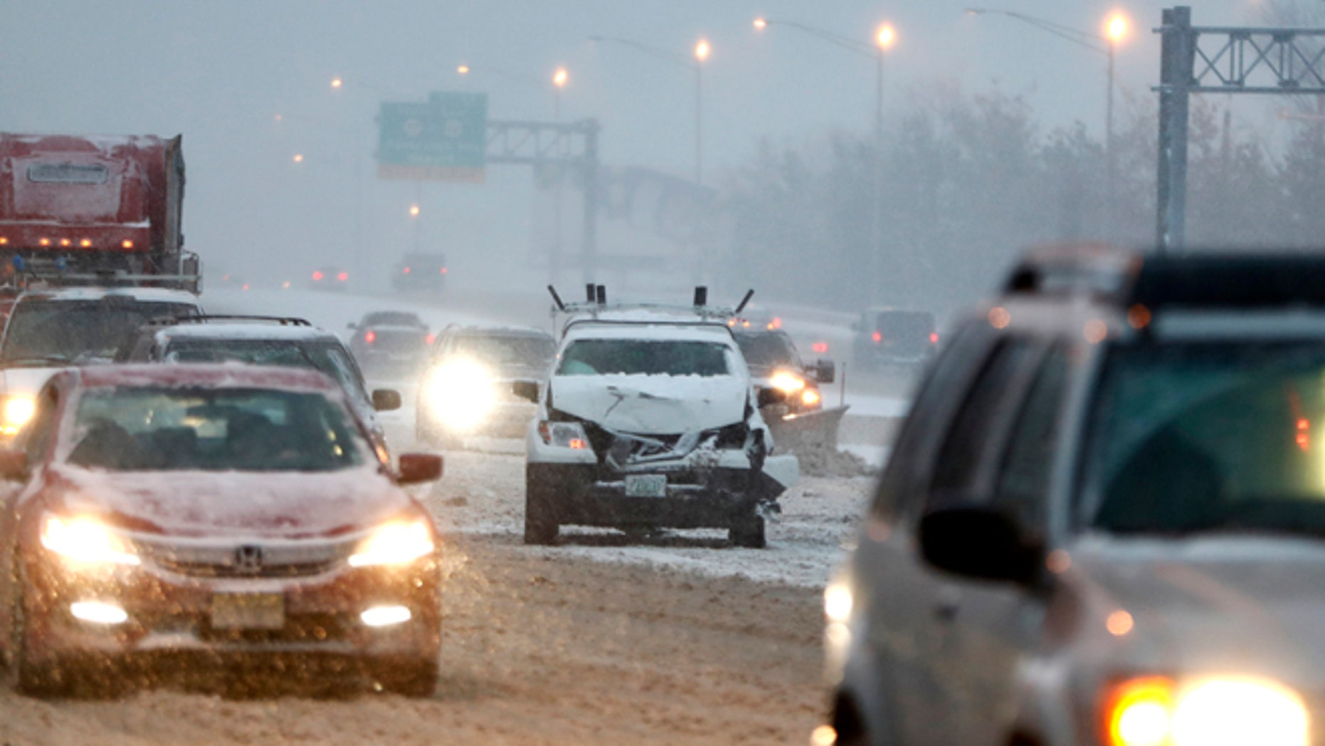 A vehicle involved in a crash sits on the fast lane of Highway Interstate 80 after an accident during a snowfall, Saturday, Dec. 17, 2016, in Lodi, N.J.