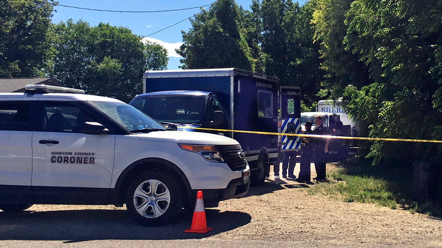 Authorities investigate a scene in Caldwell, Idaho, on Monday, June 19, 2017. Police say three people were found dead inside a home and the Canyon County Sheriff's office is investigating the deaths as possible homicides.