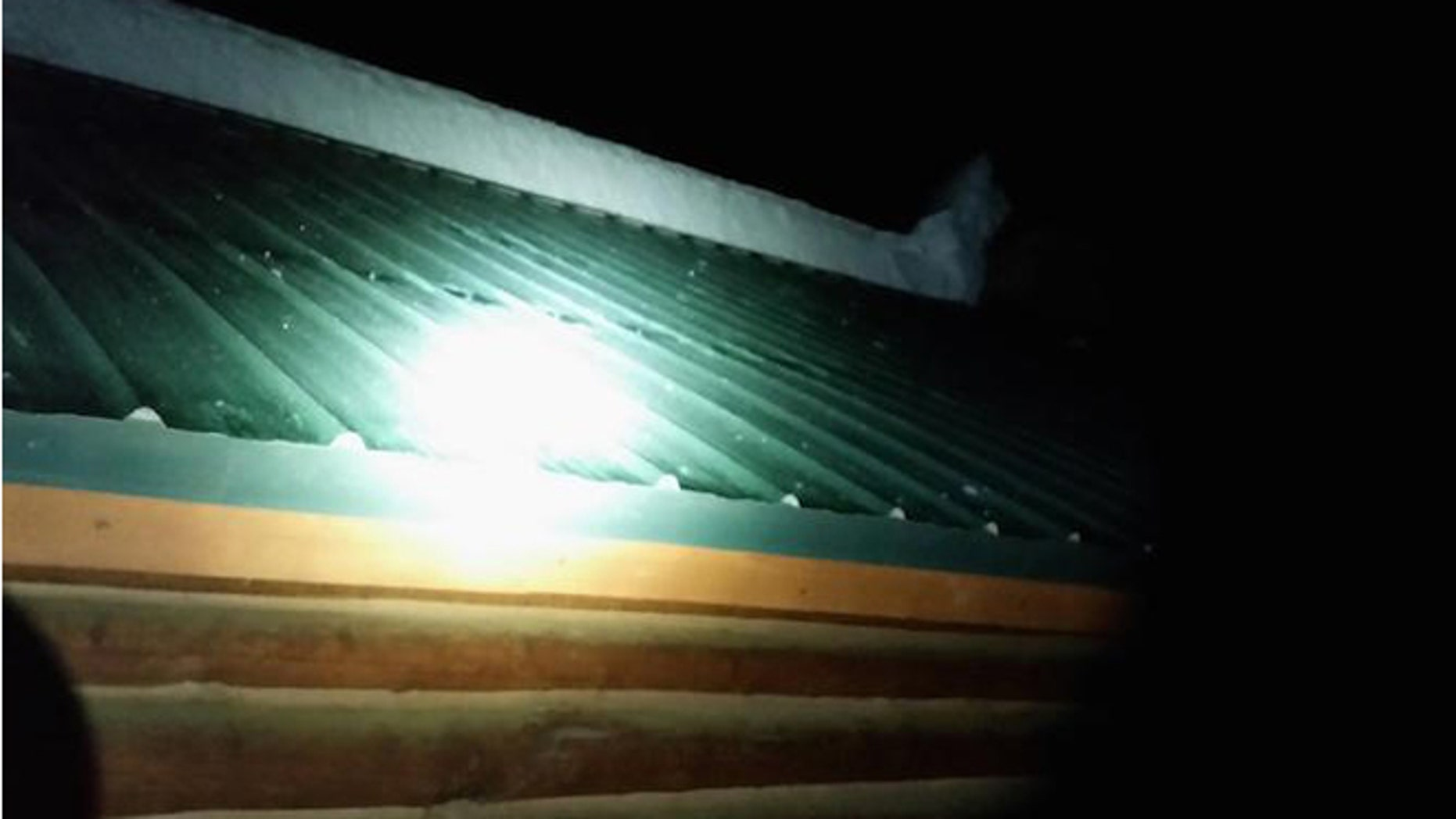 Several feet of snow fell from this cabin roof and buried three children. (EastIdahoNews.com)