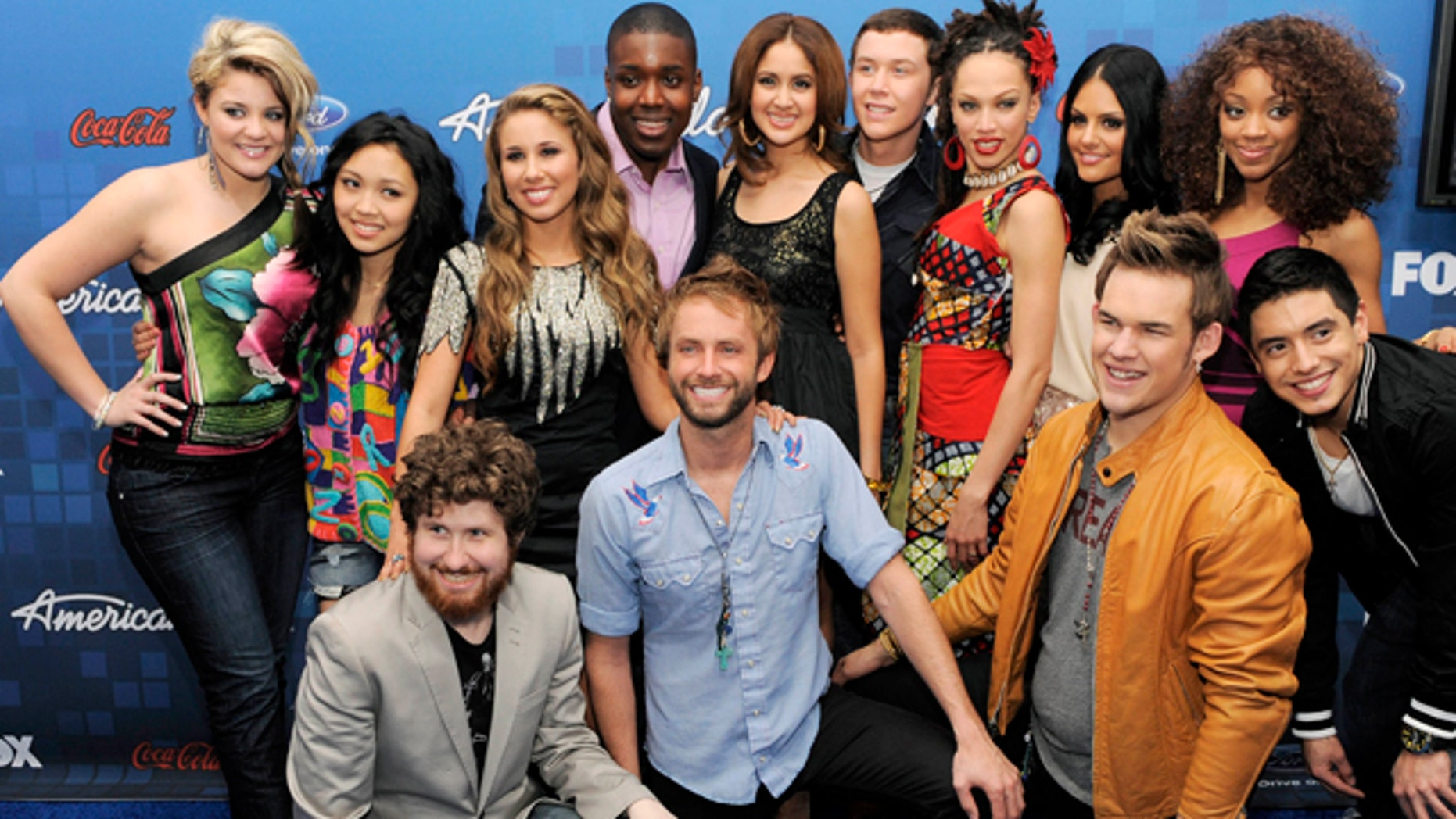 """March 3, 2011: """"American Idol"""" finalists pose together at the Finalists Party in Los Angeles. In the front row from left to right are Casey Abrams, Paul McDonald, James Durbin and Stefano Langone. In the back row from left to right are Lauren Alaina, Thia Megia, Haley Reinhart, Jacob Lusk, Karen Rodriguez, Scotty McCreery, Naima Adedapo, Pia Toscano and Ashthon Jones."""