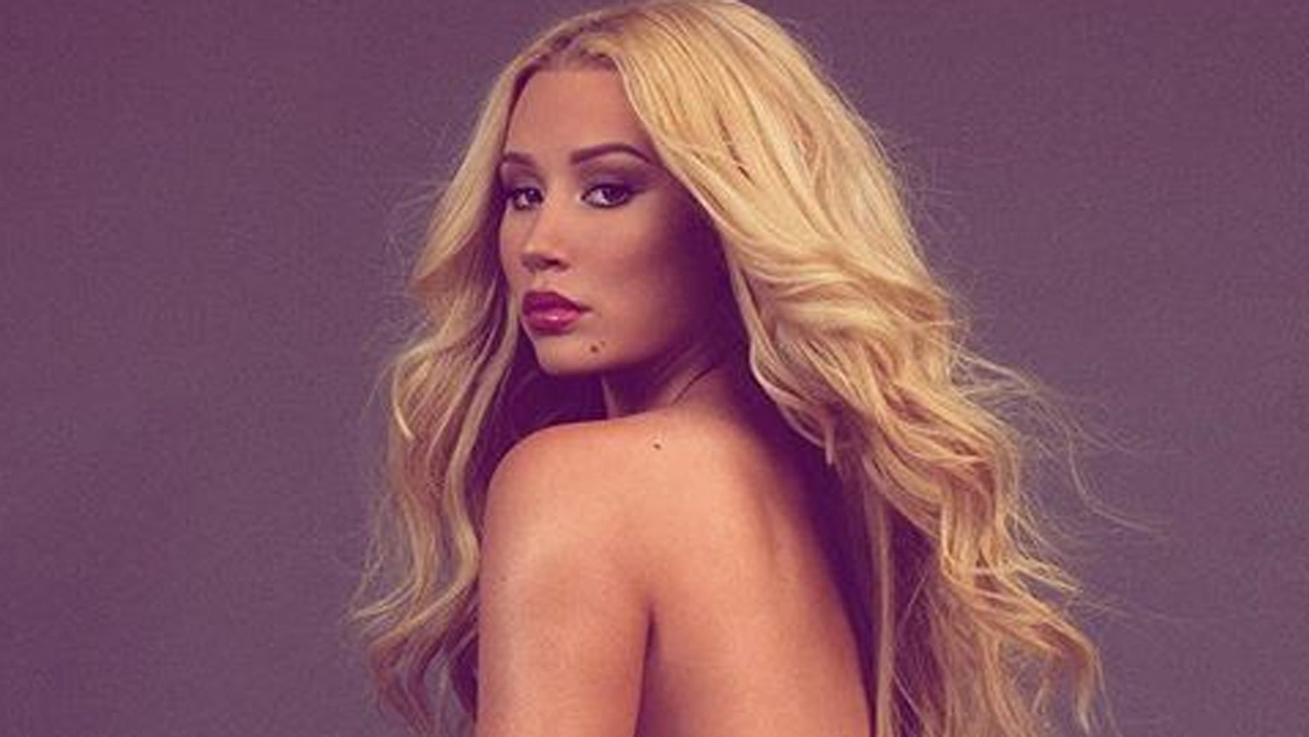Iggy Azalea defends her racy Instagram photos and claps back at haters who have criticized her for sharing the snaps.