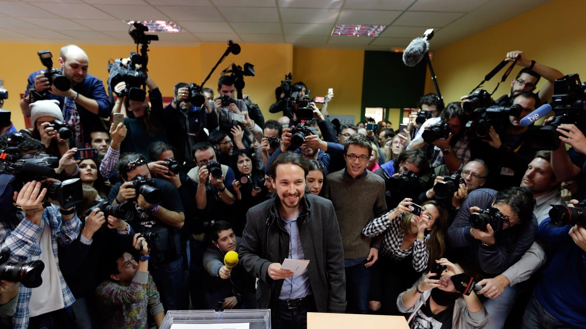 Pablo Iglesias, leader of Podemos party, casts his vote in Madrid, Sunday, Dec. 20, 2015.