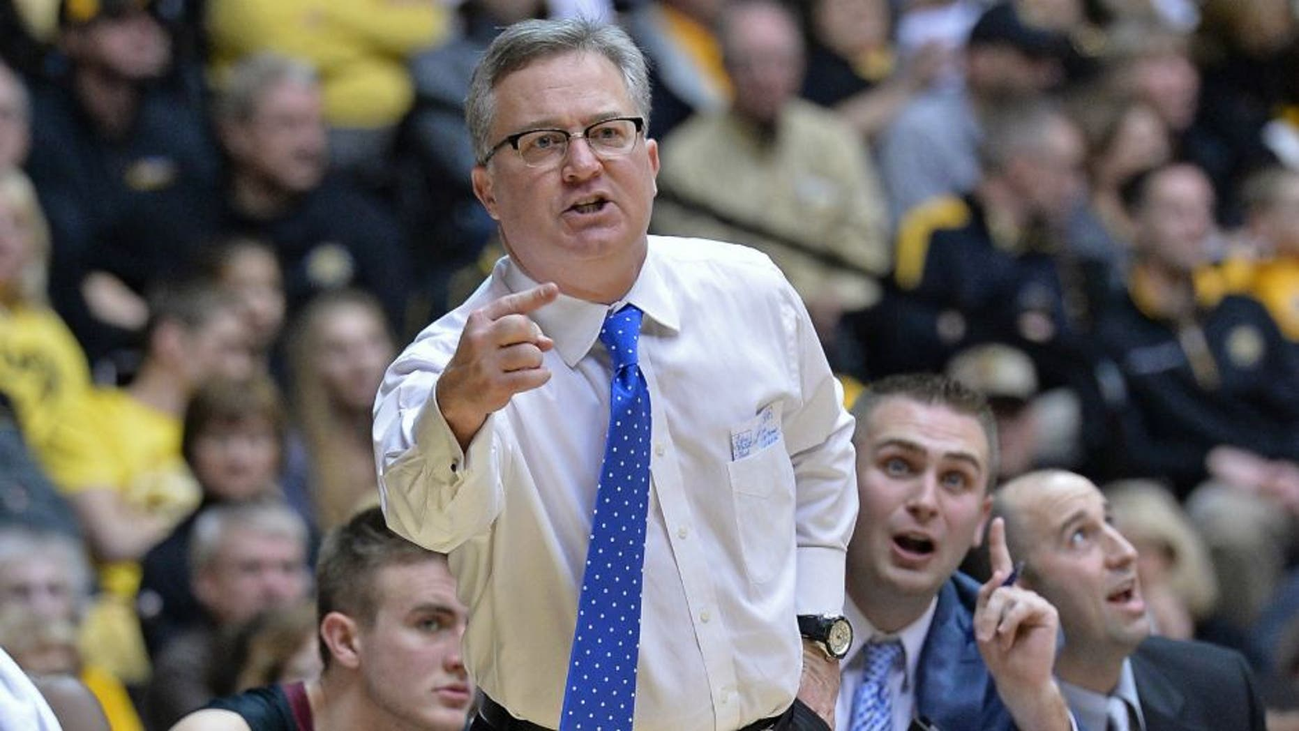 WICHITA, KS - FEBRUARY 11: Head coach Barry Hinson of the Southern Illinois Salukis calls out instructions against the Wichita State Shockers during the first half on February 11, 2014 at Charles Koch Arena in Wichita, Kansas. Wichita State won 78-67. (Photo by Peter Aiken/Getty Images)