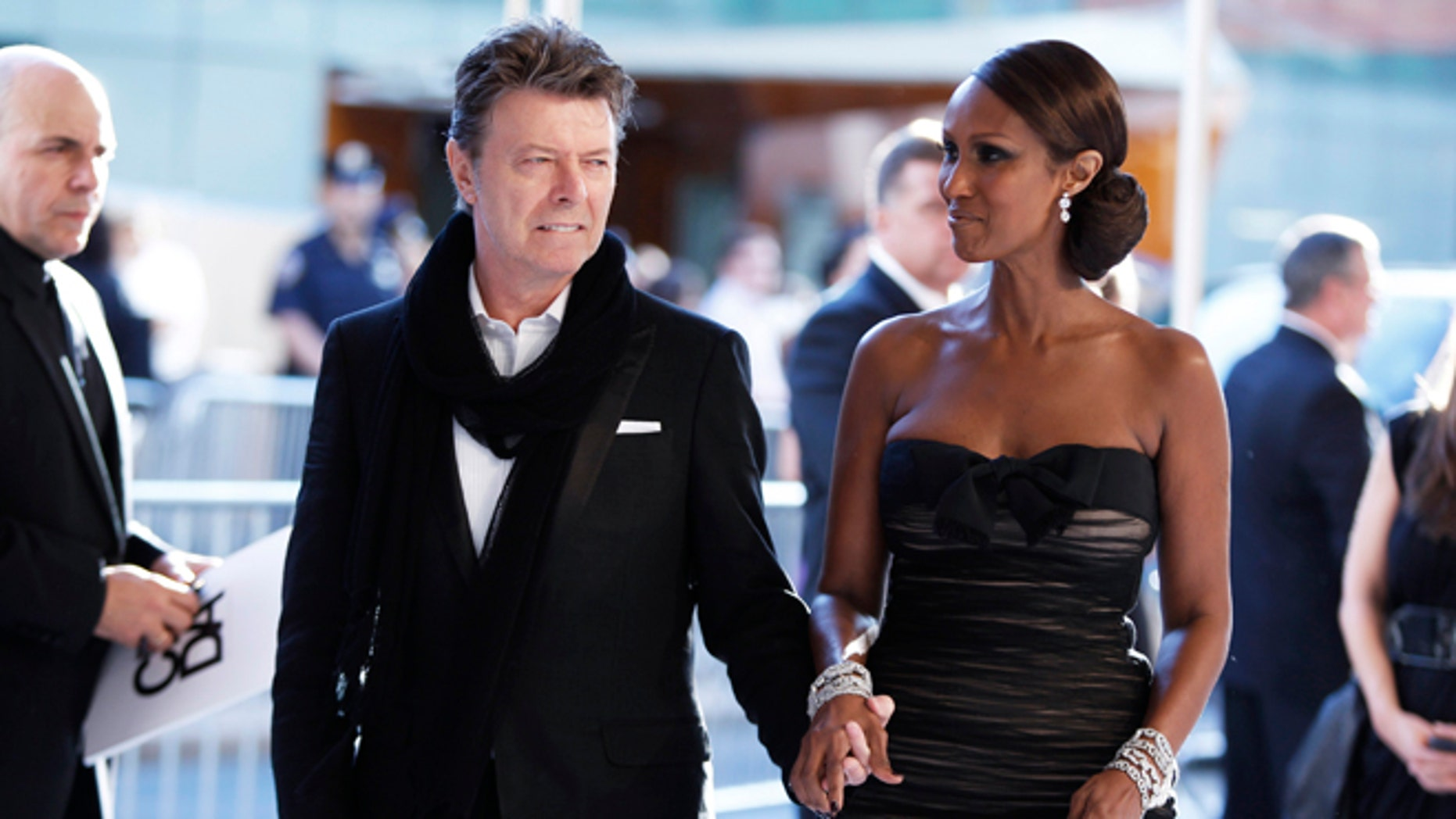 June 7, 2010. Singer David Bowie arrives with his wife Iman to attend the Council of Fashion Designers of America (CFDA) fashion awards in New York.
