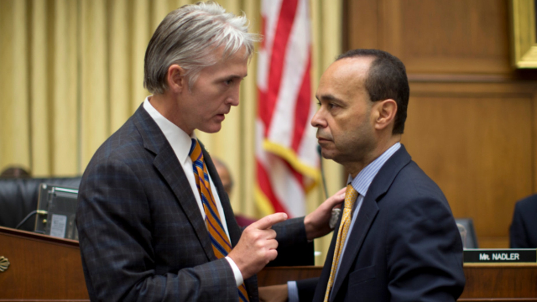 June 18, 2013: House Judiciary Committee member Rep. Trey Gowdy, R-S.C., sponsor of the Strengthen and Fortify Enforcement Act, left, talks with Rep. Luis Gutierrez, D-Ill., on Capitol Hill in Washington.