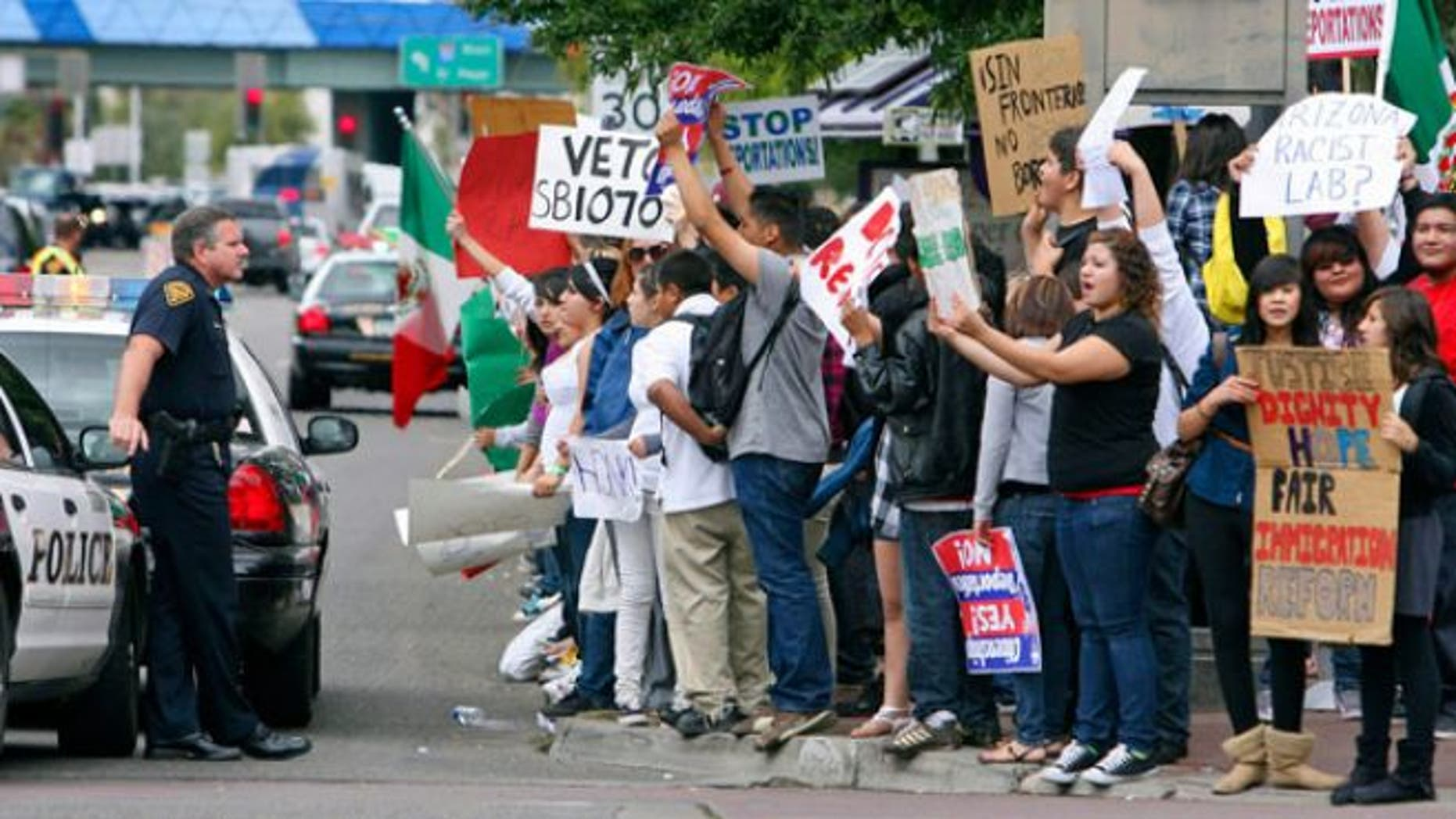 FILE: Hundreds of protesters rally against Arizona's immigration law in Tucson.