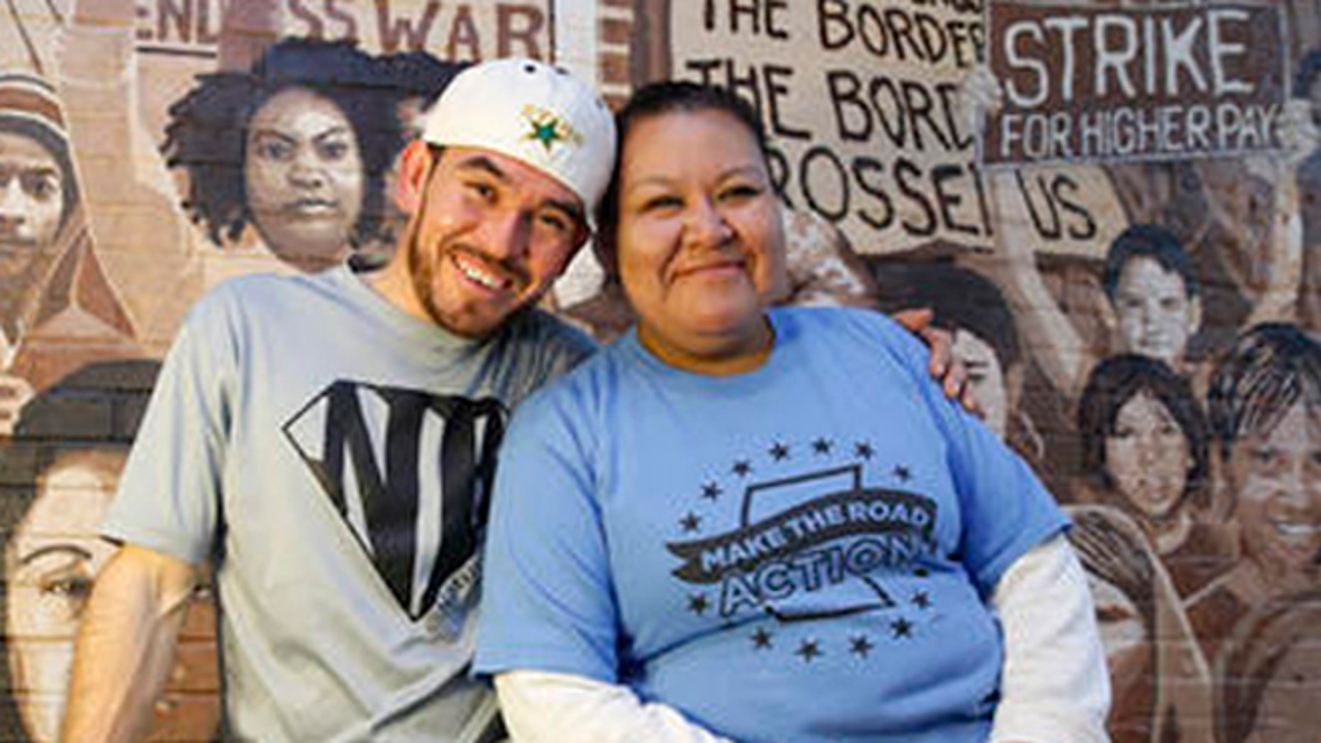 In this Wednesday, Oct. 26, 2016 photo, Guatemalan immigrant and construction worker Mauricio Pelaez-Alvarez, 33, left, poses for a photograph with immigrant rights activist Juana Alvarez, 39, (no relation) after each shared their thoughts with The Associated Press about the upcoming presidential election at Make the Road New York's Brooklyn offices in New York. Although Alvarez has lived in the United States since she emigrated at age 16, and Pelaez-Alvarez has been in the U.S. for ten years, neither can vote in the November election.  (AP Photo/Kathy Willens)