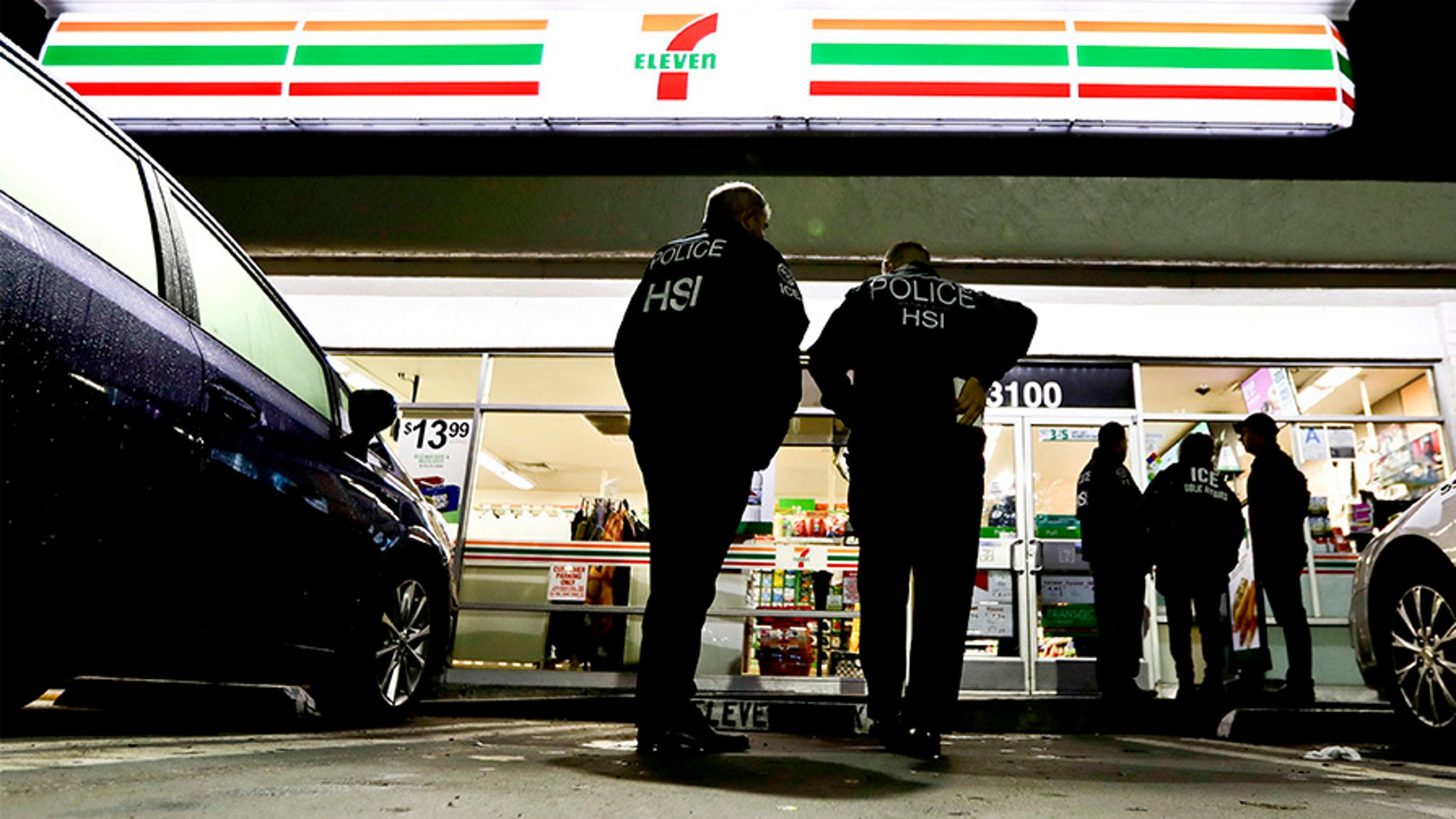 U.S. Immigration and Customs Enforcement agents aid they targeted about 100 7-Eleven stores nationwide Wednesday to open employment audits and interview workers.