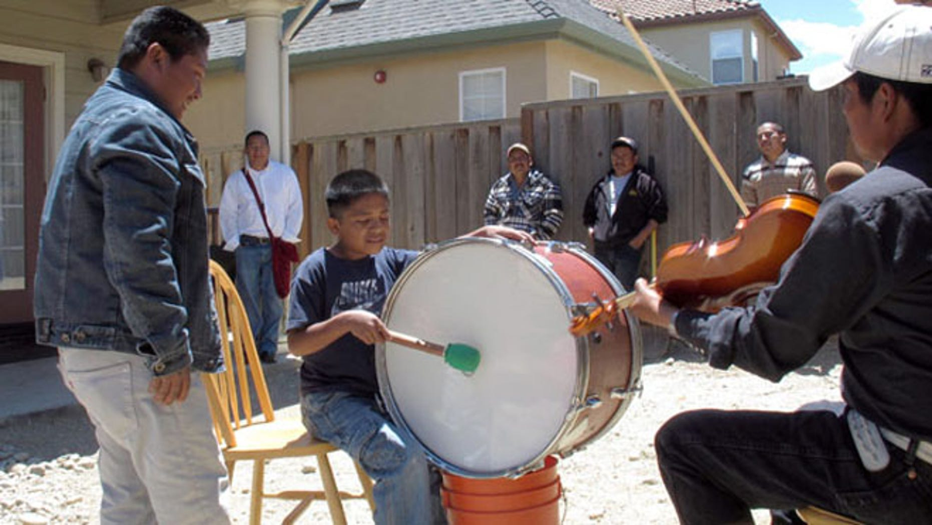 Trique children, whose families migrated from the Mexican state of Oaxaca, learn how to play traditional instruments in Greenfield, Calif. (AP Photo/Gosia Wozniacka)