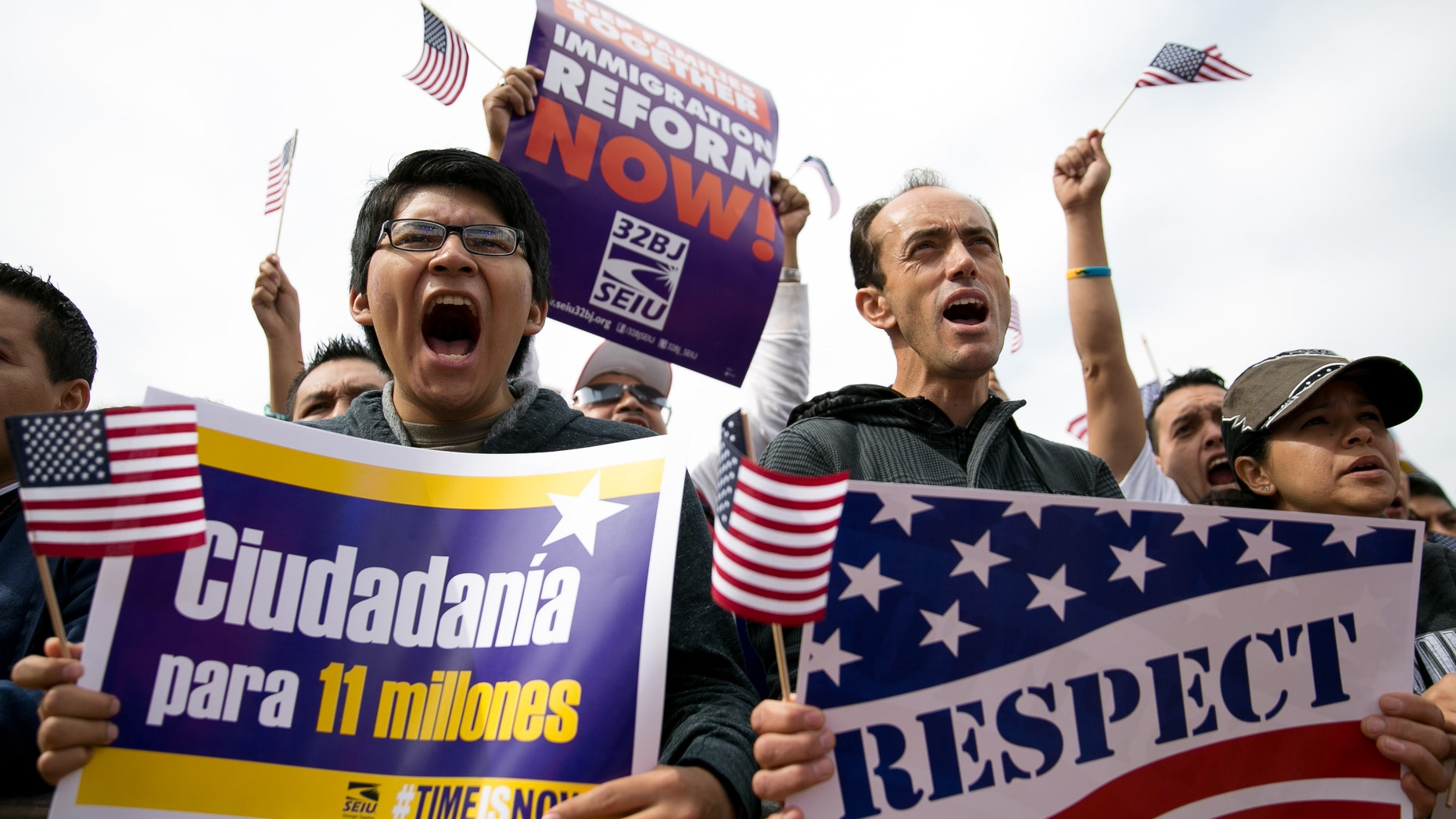 WASHINGTON, DC - OCTOBER 8:  (L to R) Hernan Morales, a student at American University, and Juan Martinez, cheer during a rally in support of immigration reform, in Washington, on October 8, 2013 in Washington, DC. Last week, House Democrats introduced their own immigration reform bill. (Photo by Drew Angerer/Getty Images)