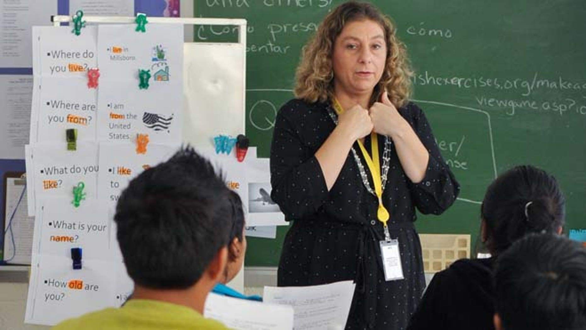 Sept. 11, 2014: In this photo, teacher Lori Ott, center, of Millsboro, Del., addresses students in the Accelerating Preliterate English Language Learners (A.P.E.L.L) class at the G.W. Career Educational Center in Frankford, Del.