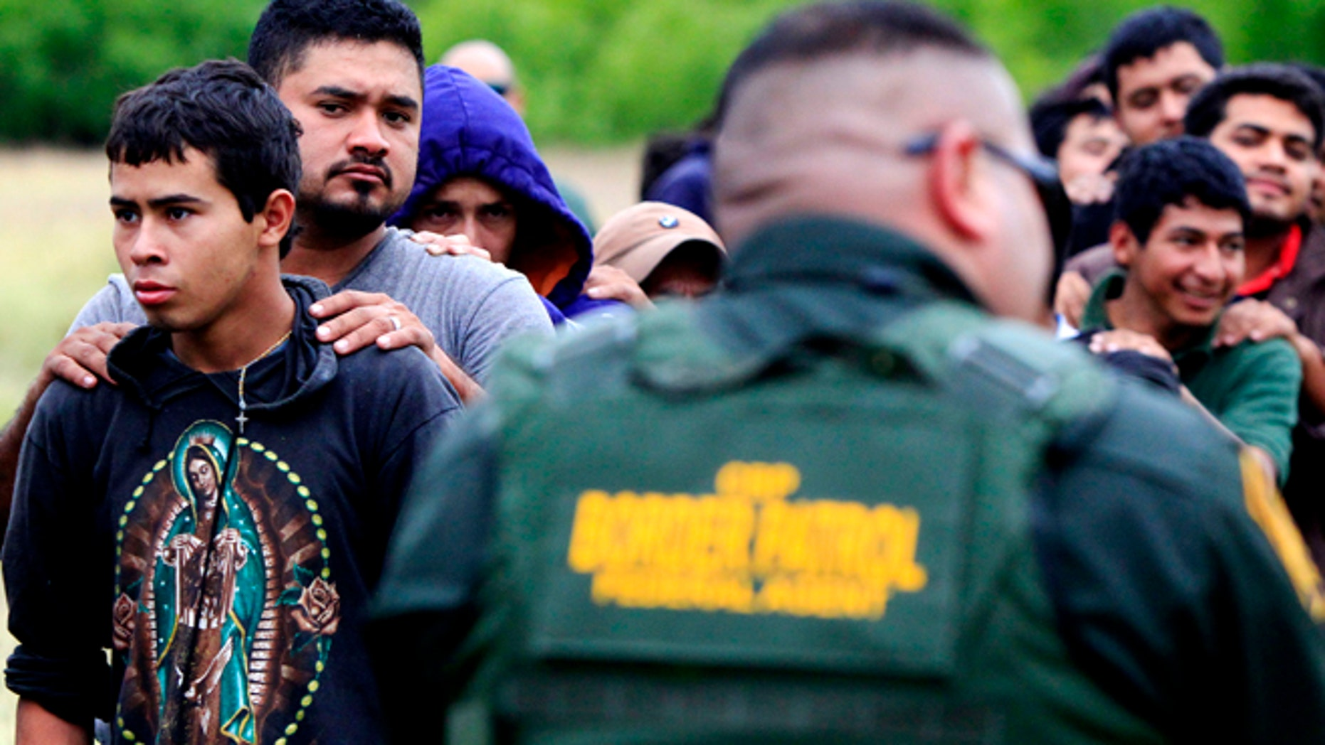 April 17, 2014: Suspected illegal immigrants being detained  by U.S. Border Patrol agents, in  McAllen, Texas.