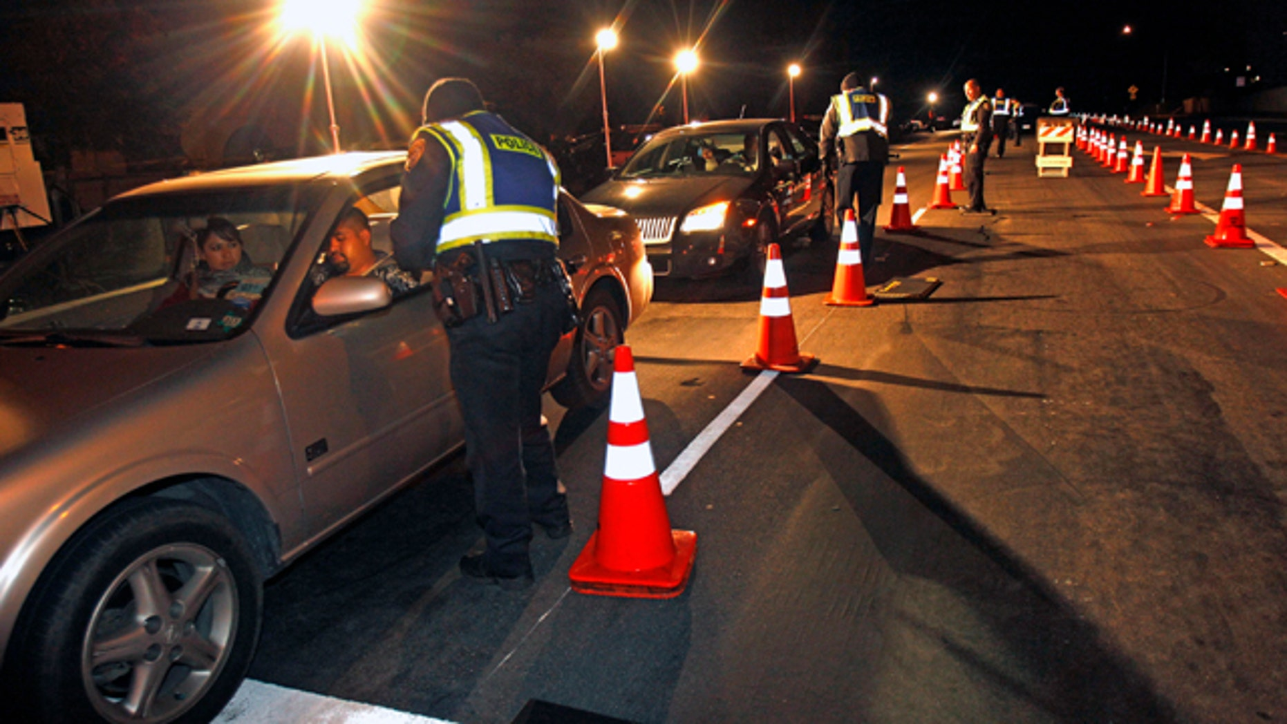 Dec. 16, 2011: Police officers check drivers at a sobriety checkpoint in Escondido, Calif.