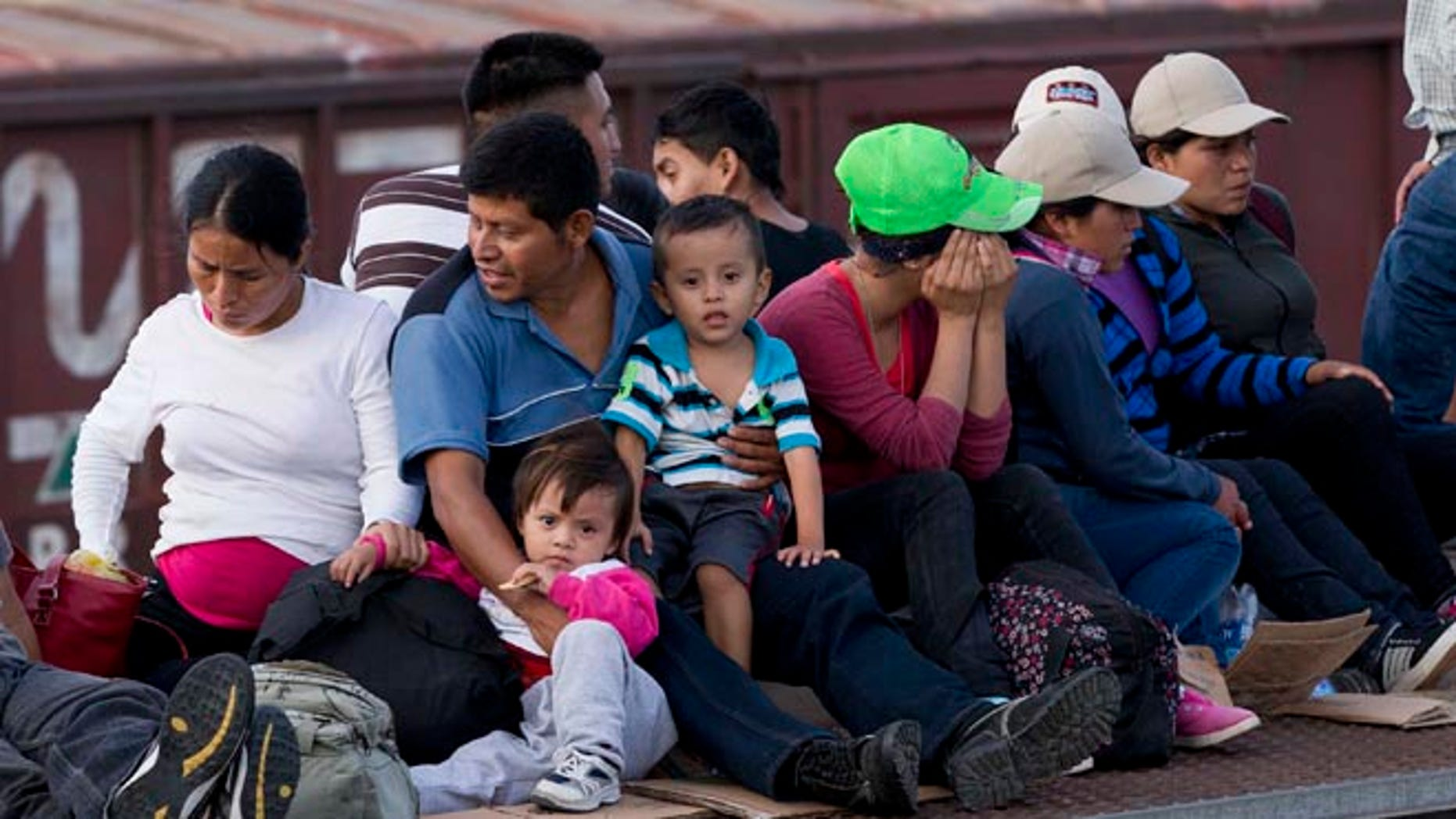 Central Americans ride a freight train toward the U.S.-Mexico border, on July 12, 2014.