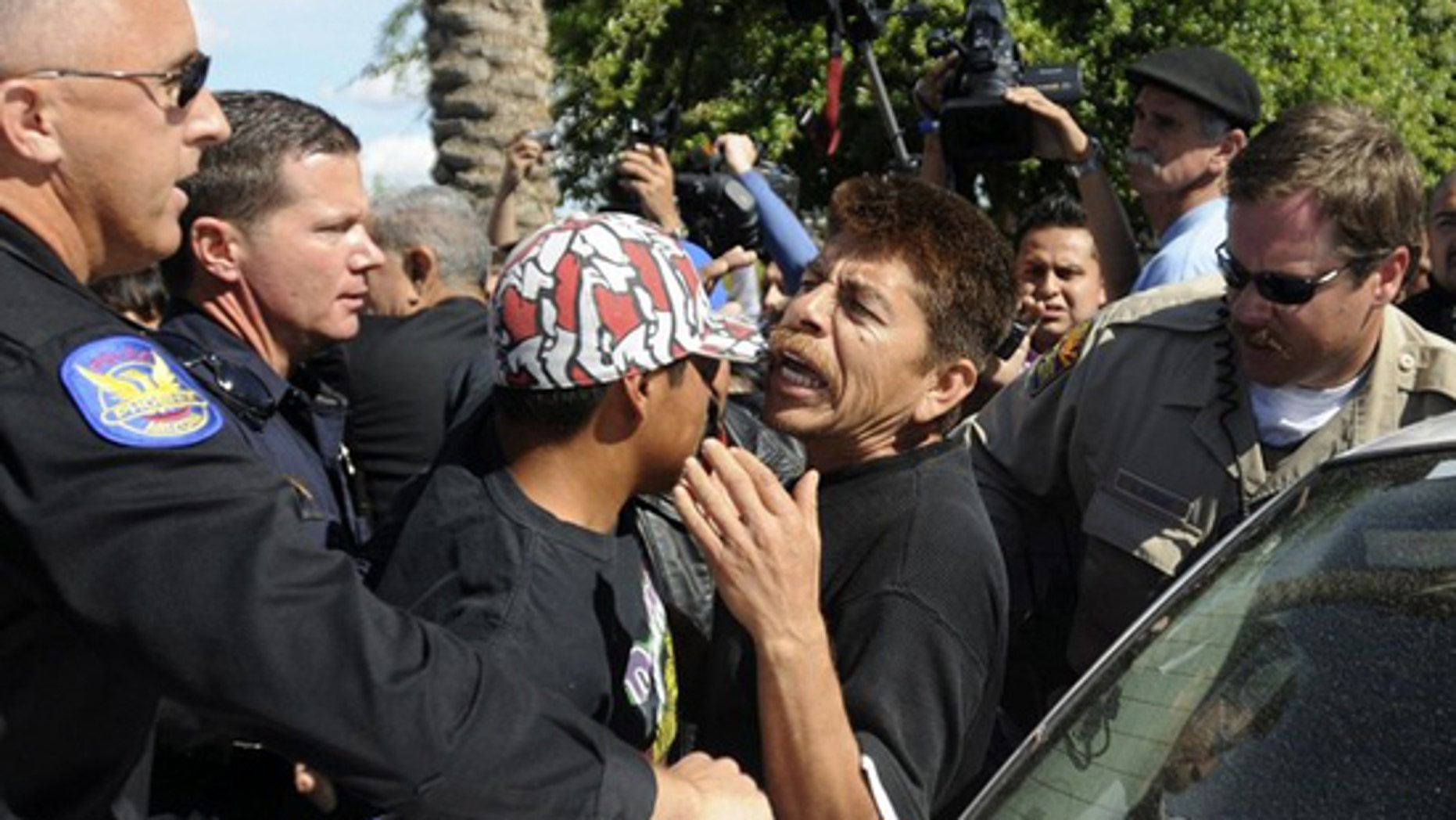 Protesters interact with police during a demonstration outside the Arizona State Capitol in Phoenix, Arizona, April 23, 2010 in protest of an immigration law signed by Arizona Governor Jan Brewer. (Reuters)