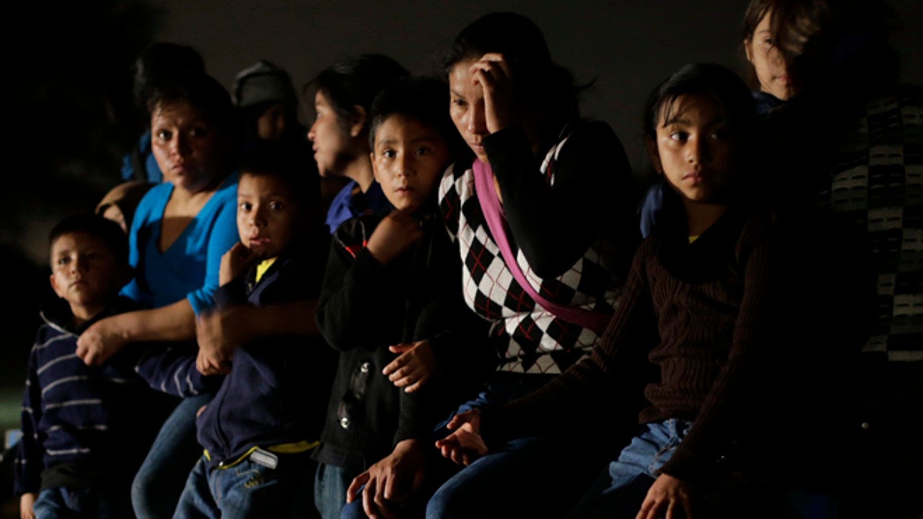 June 25, 2014: A group of immigrants from Honduras and El Salvador who crossed the U.S.-Mexico border illegally are stopped in Granjeno, Texas. Jim Gilchrist, founder and president of the Minuteman Project, said the current immigration flood in the state highlighted the need for a return. (AP/Eric Gay, File)