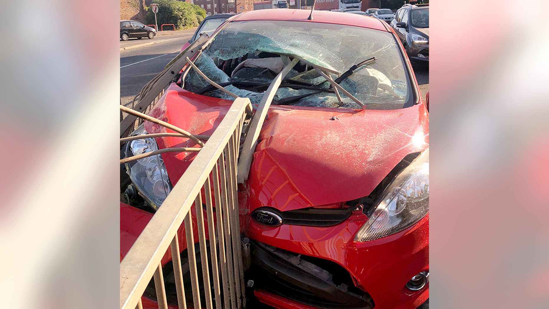 A motorist cheated death after a metal pole pierced his windscreen during a crash - missing his head by inches.  See NTI story NTICRASH.  The unnamed driver had a miracle escape when he ploughed into metal railings sending a 6ft long metal 'spear' from a barrier smashing through the front window.  Shocking pictures show just how close the pole came to hitting the motorist following the horror smash last Tuesday (10/7).  Emergency services were called to the scene on John Adams Way, in Boston, Lincs., but the Ford Fiesta driver did not require any medical treatment.